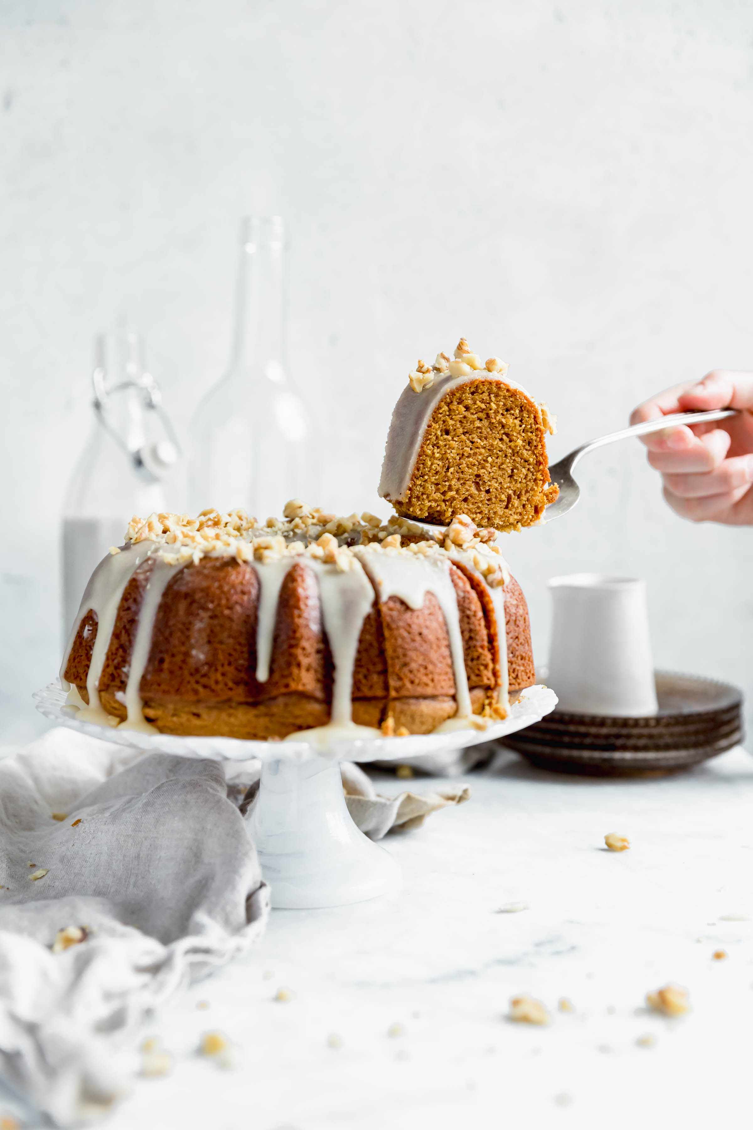 sweet potato bundt cake with a piece cut out
