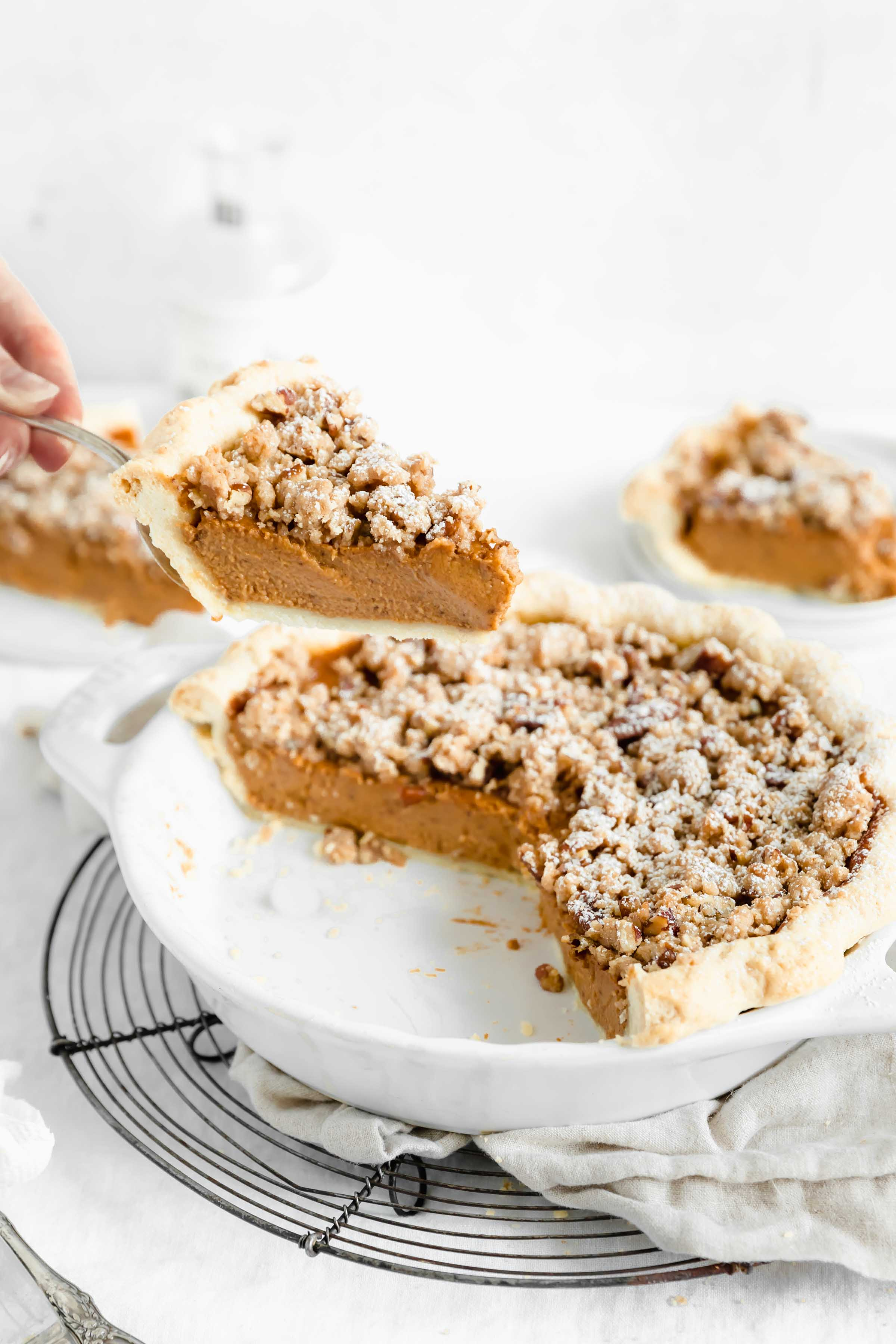 This perfectly spiced sweet potato pie with a decadent, buttery almond streusel. The perfect addition to your pie table this Thanksgiving!