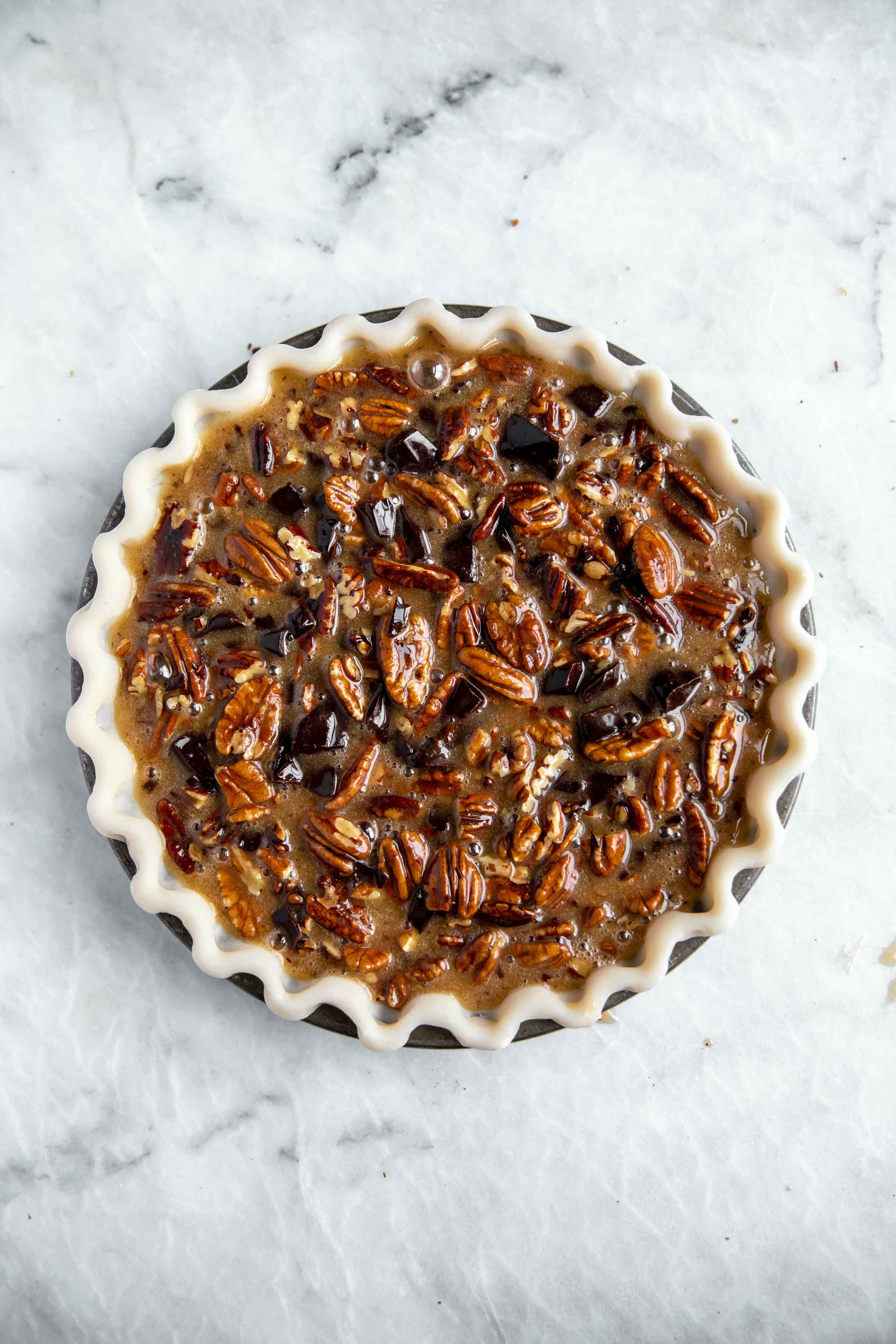 overhead shot of unbaked pecan pie