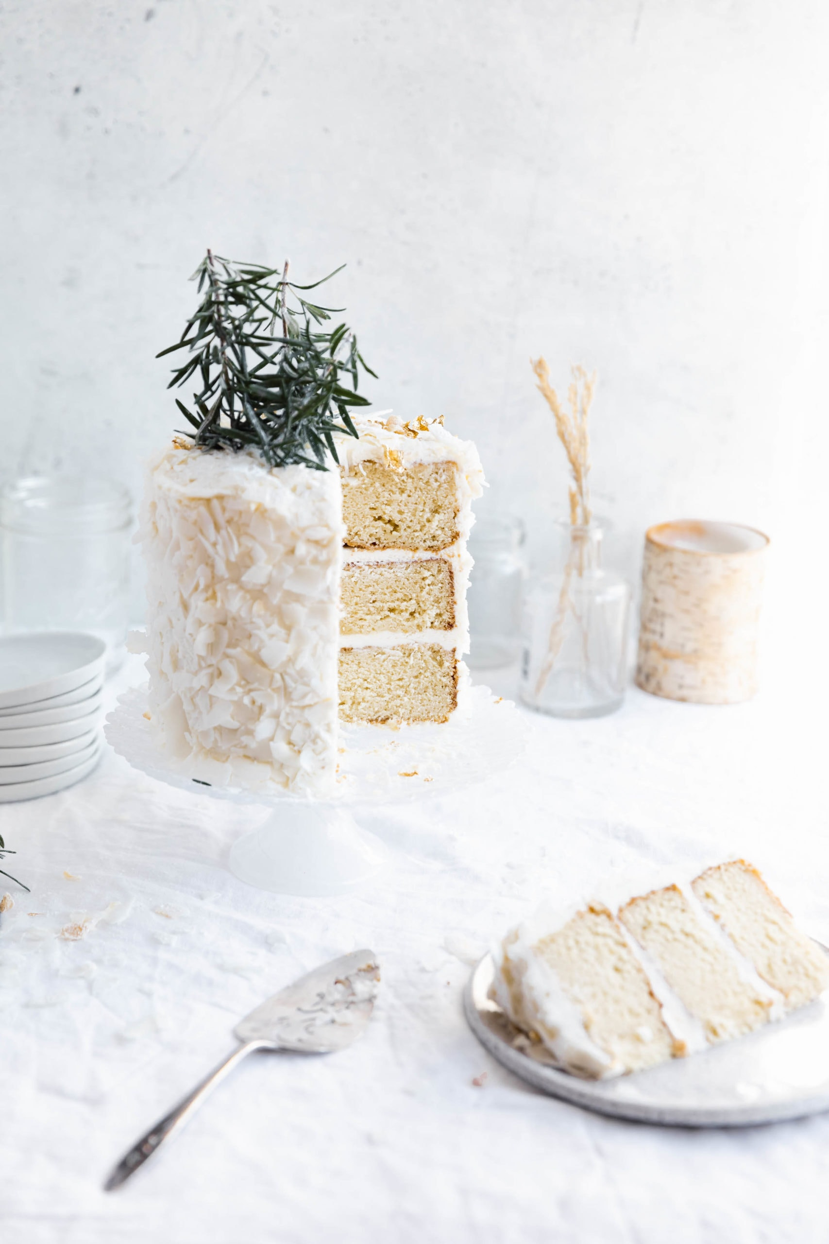 christmas coconut cake with a piece taken out