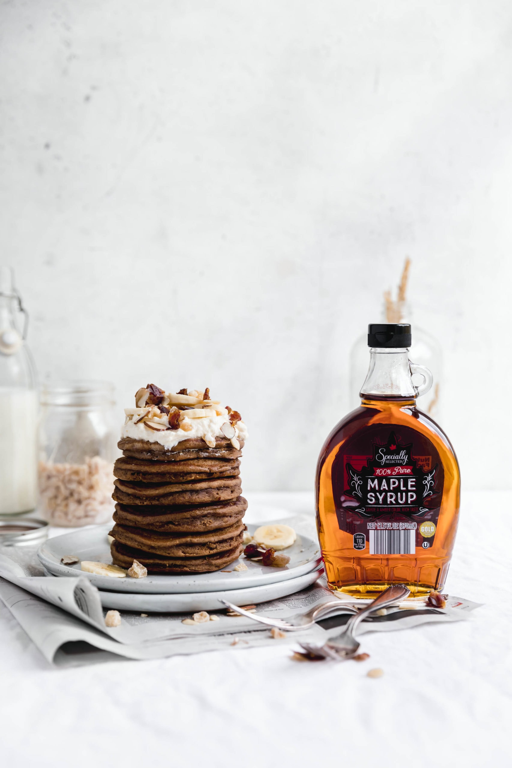 Start your Christmas morning off right with a fat stack of these fluffy gingerbread pancakes. Topped with a healthy pour of maple syrup, these pancakes are perfect for the holidays!