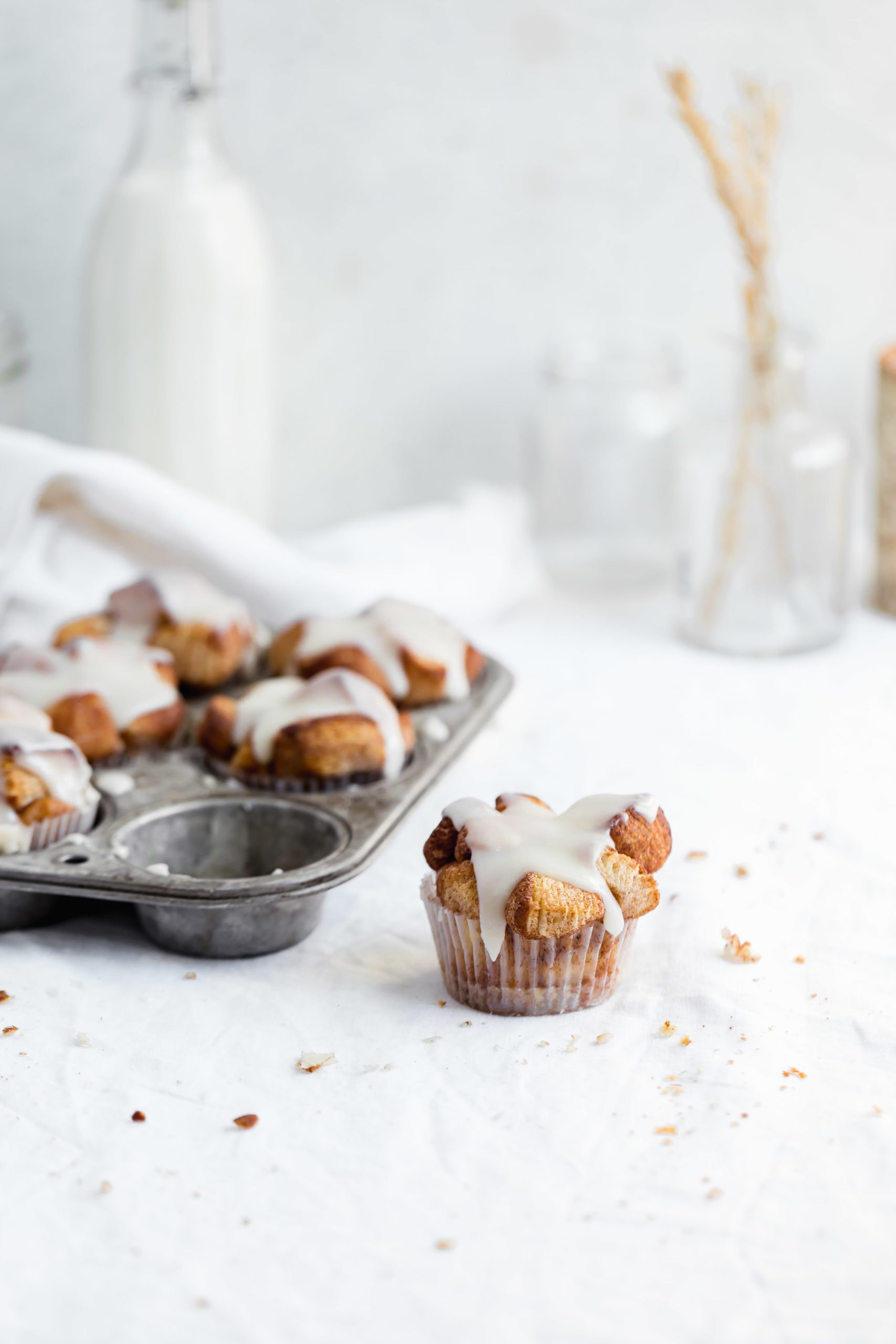 monkey bread muffins in a cupcake tin with one out of the tin