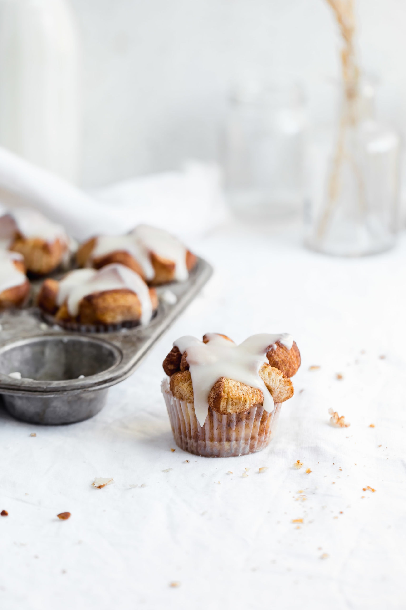 monkey bread muffins drizzled with a vanilla glaze