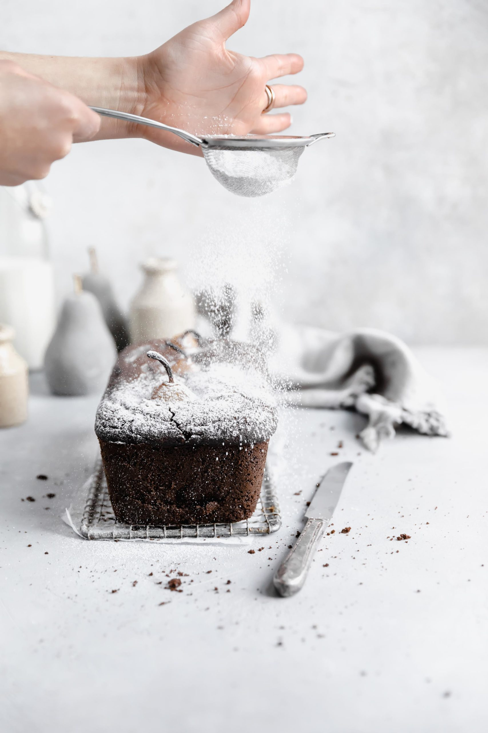 poached pear gingerbread cake with a dusting of powdered sugar