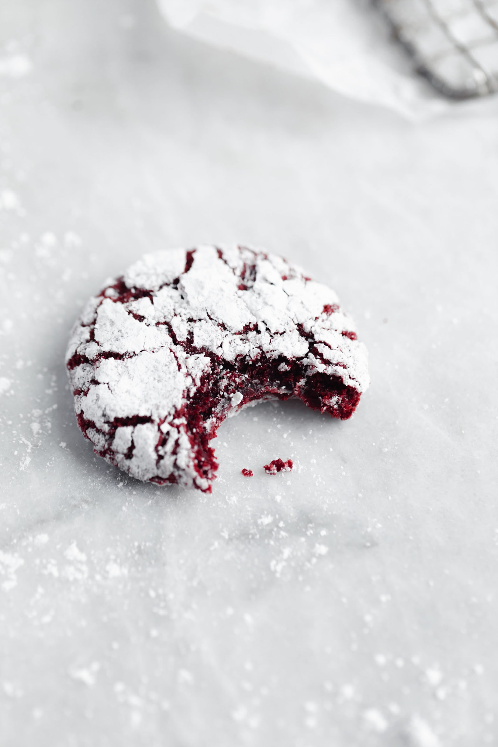 Too goo to resist! Fudgy homemade red velvet Christmas cookie with a bite taken out!