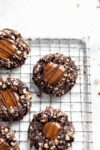 These turtle thumbprint cookies complete with a gooey caramel center and pecan coating. Try not to eat five?