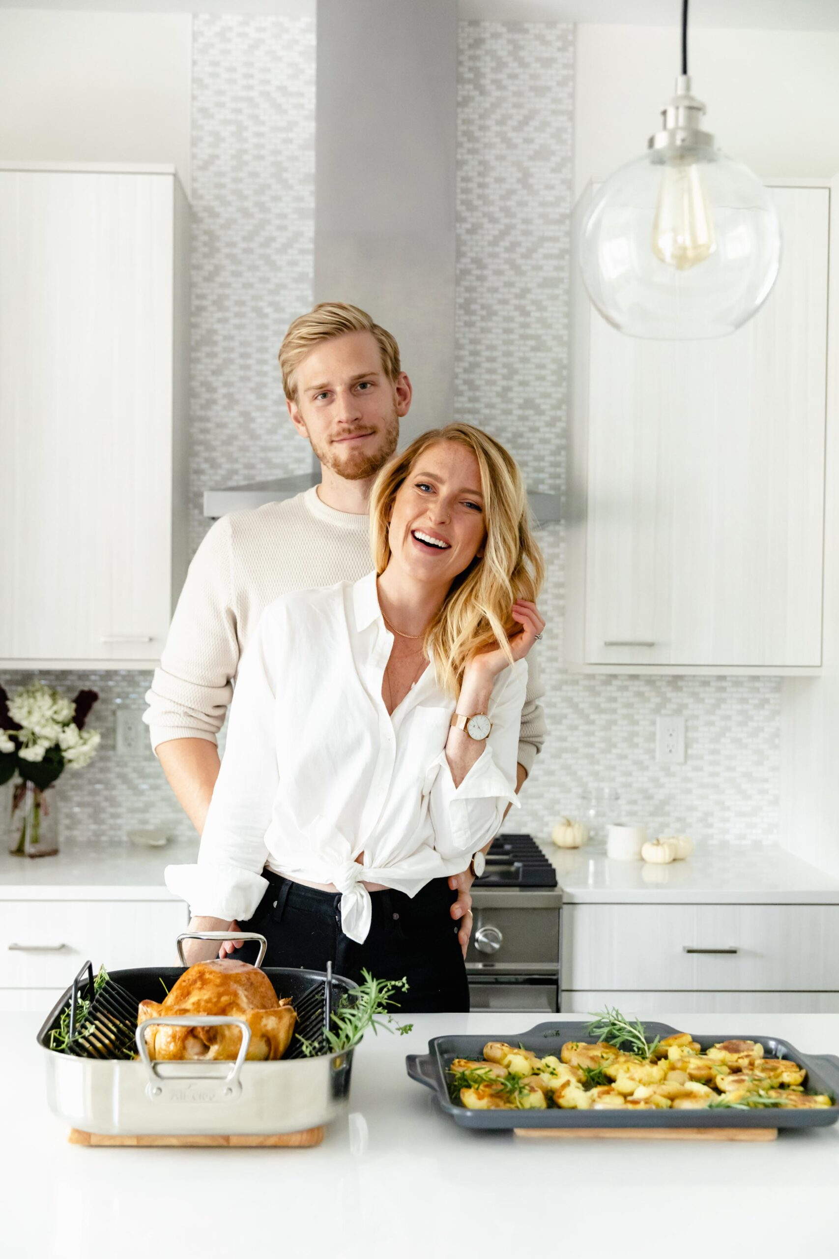 newlywed couple entertaining in kitchen