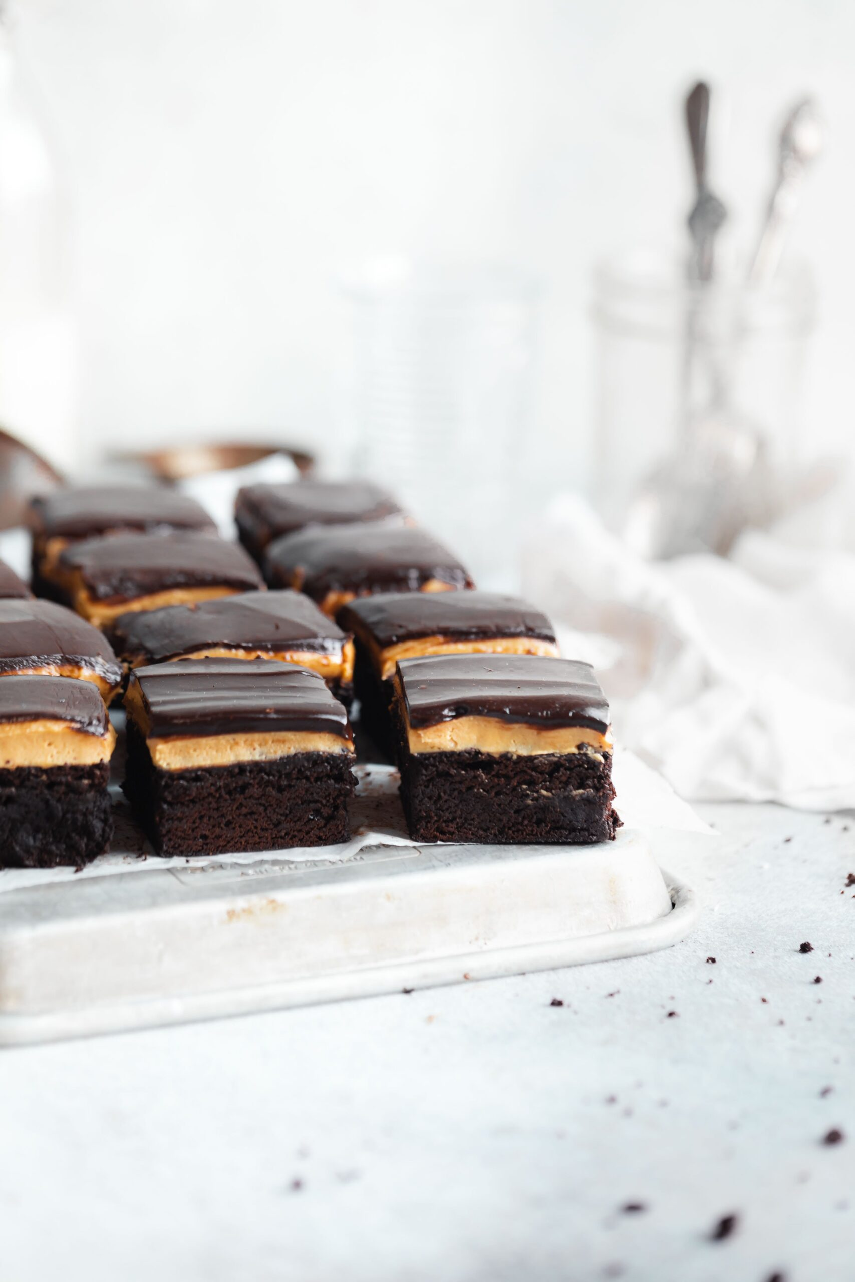 fudgy brownies topped with a thick layer of peanut butter and chocolate ganache