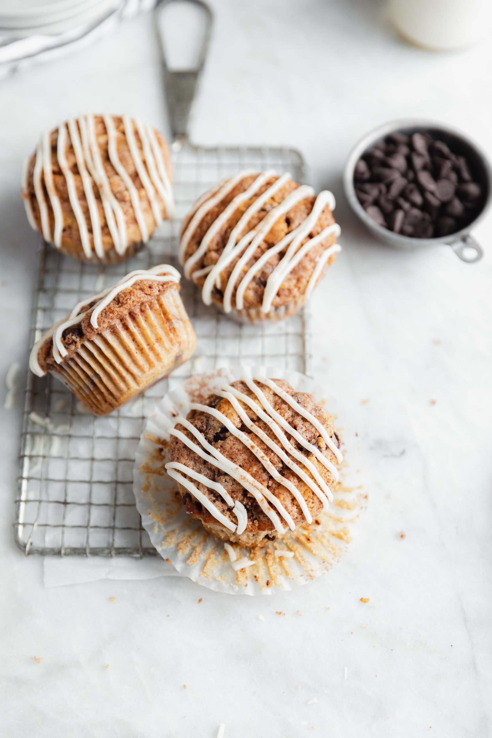 buttery cinnamon swirl chocolate chip muffins drizzled with icing