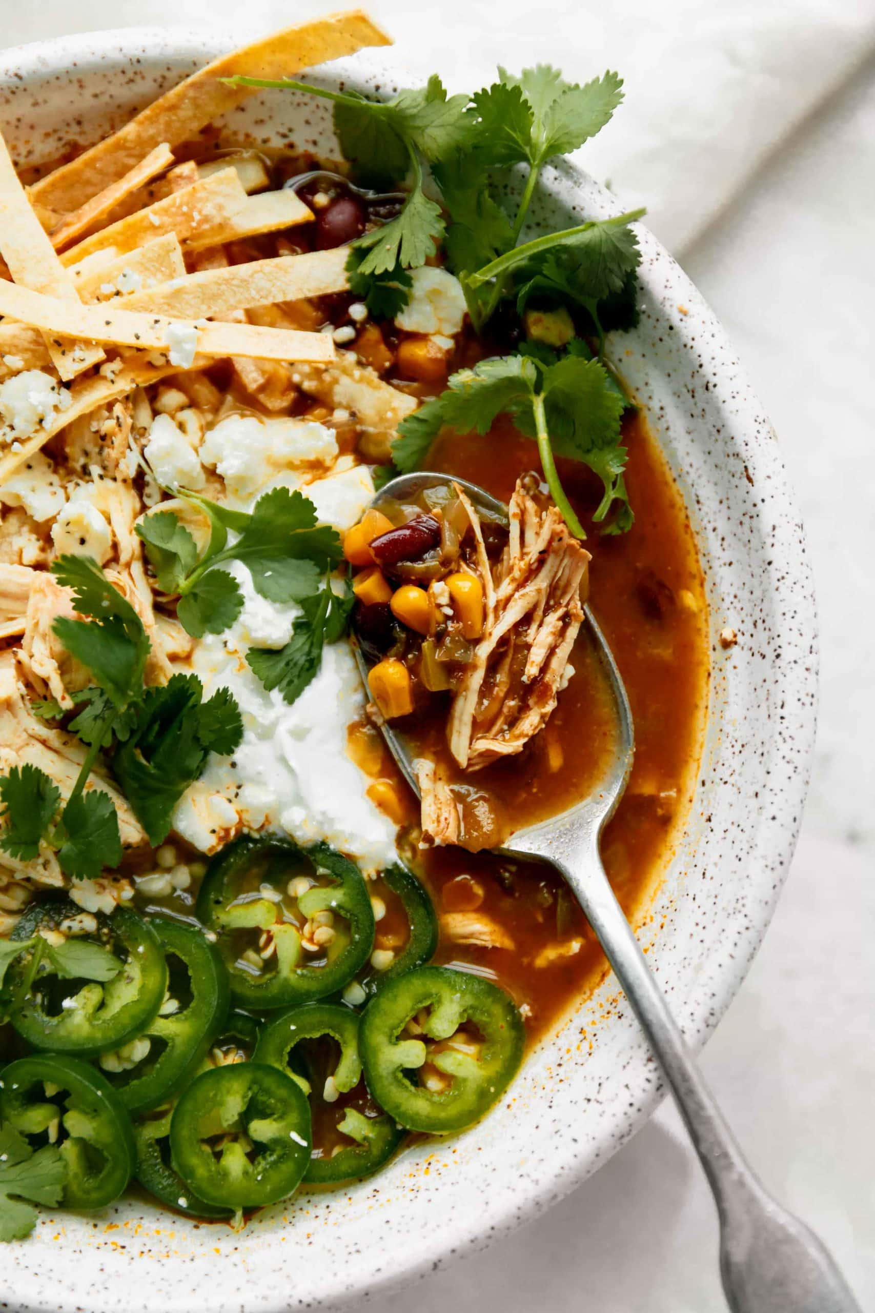 instant pot chicken tortilla soup with a spoon