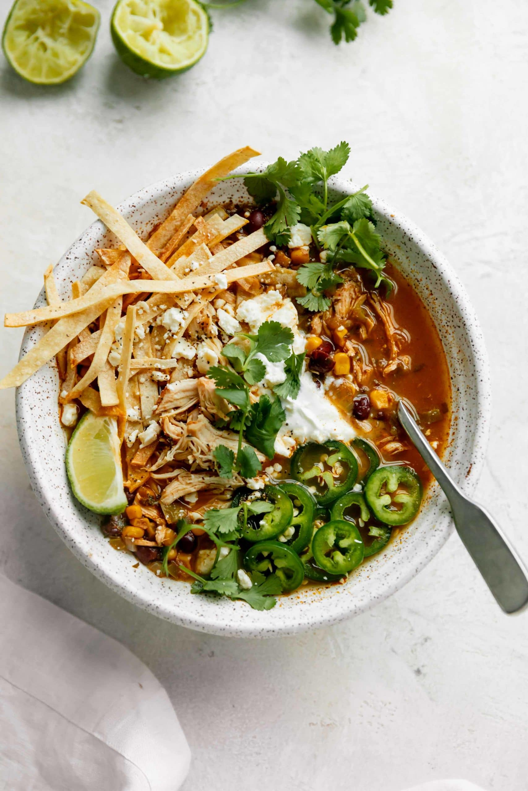 chicken tortilla soup recipe topped with crunchy tortilla strips