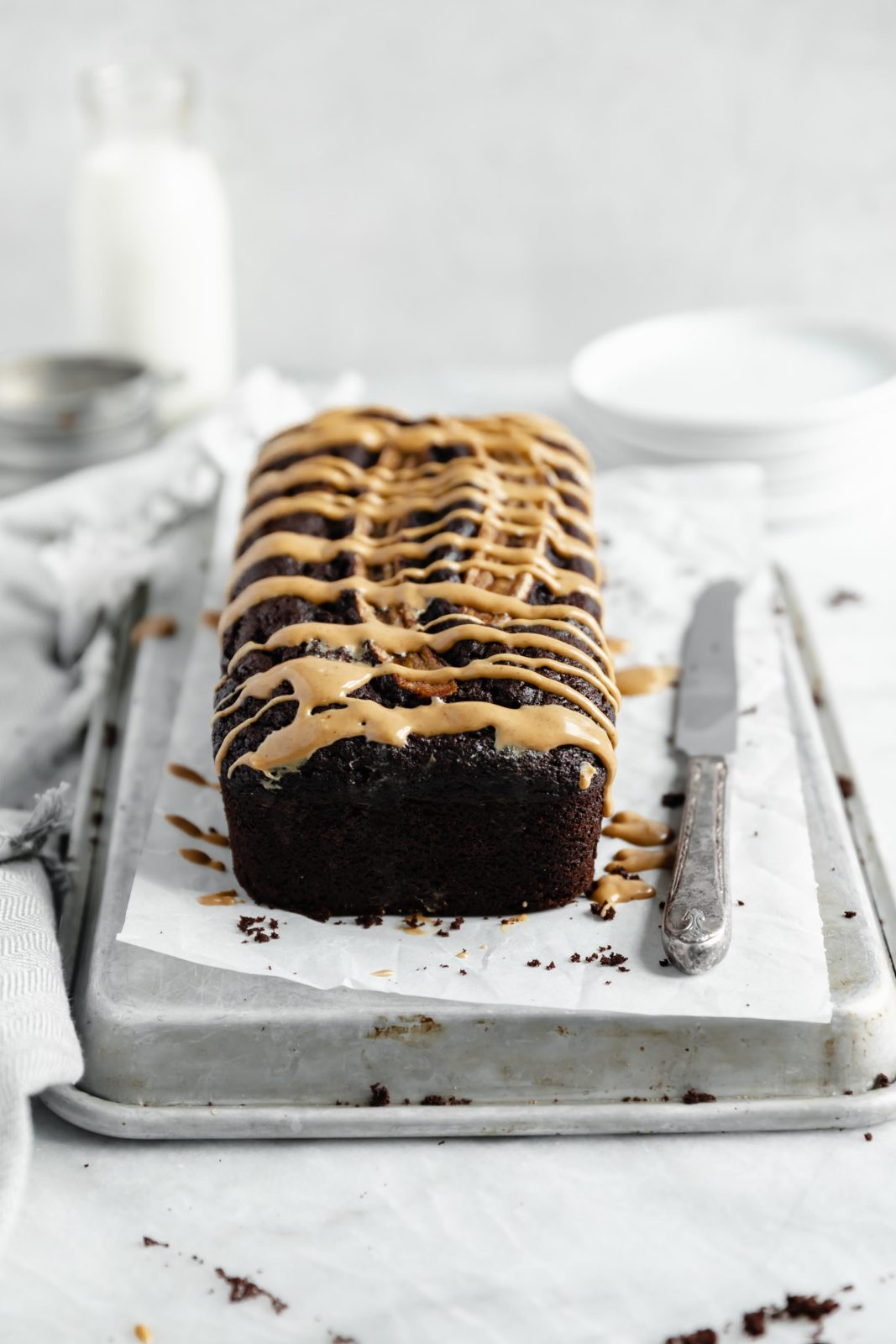 easy peanut butter chocolate banana bread loaf with a healthy drizzle of peanut butter on top
