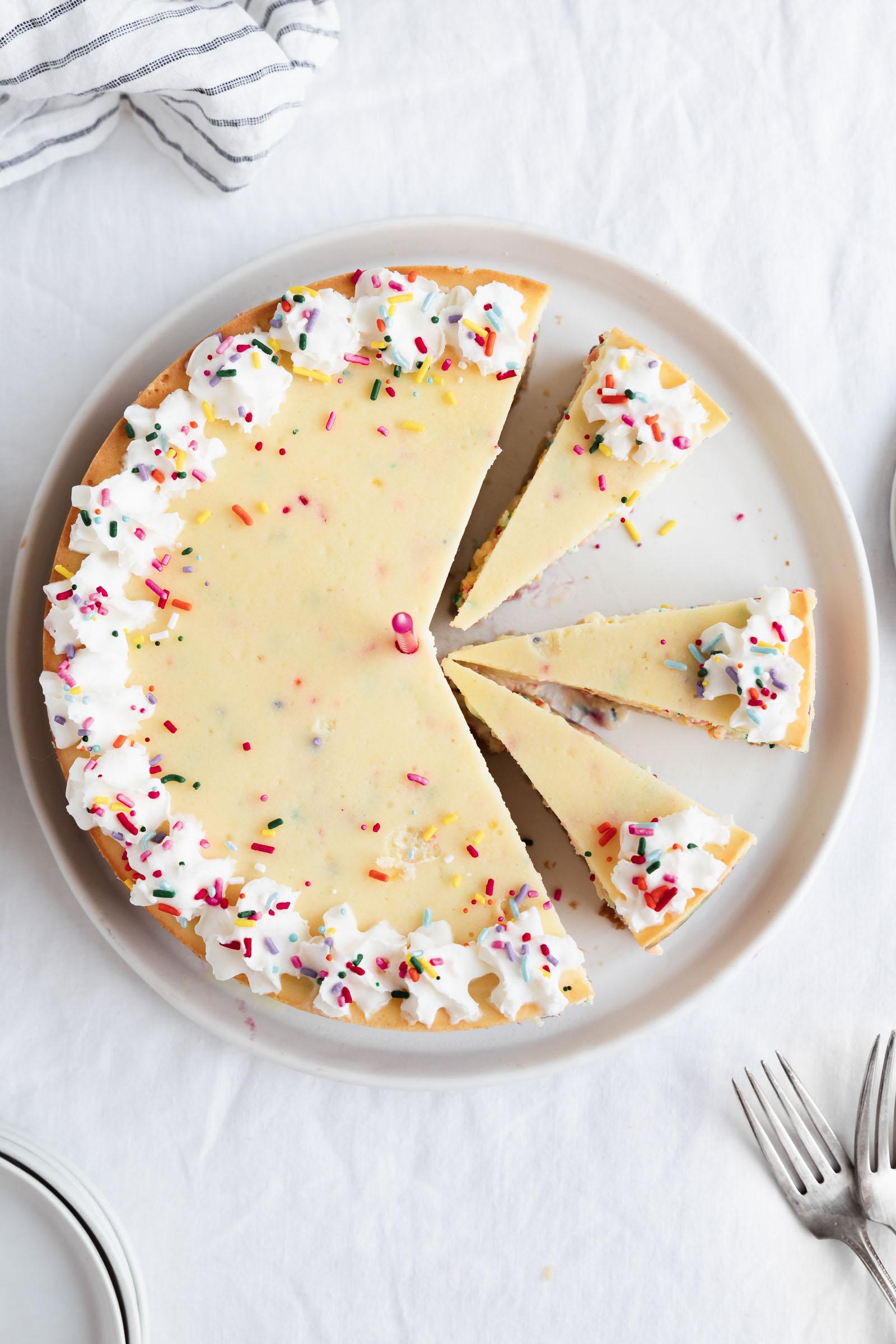 overhead shot of birthday cheesecake with whipped cream