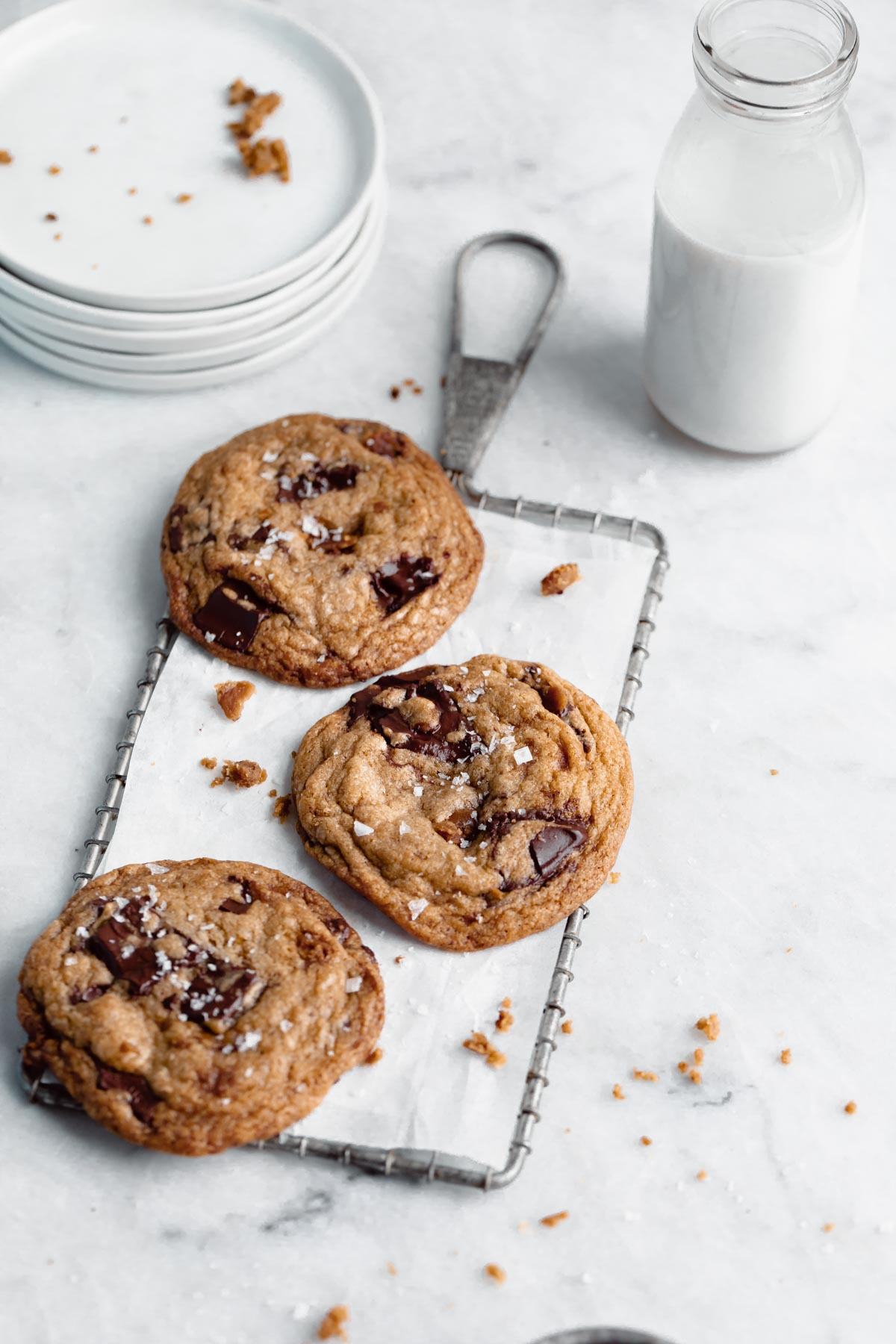 gooey brown butter toffee chocolte chip cookies on a cooling rac