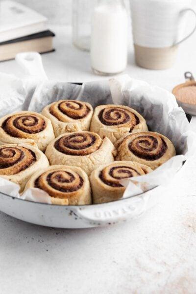gluten free vegan cinnamon rolls in a round pan