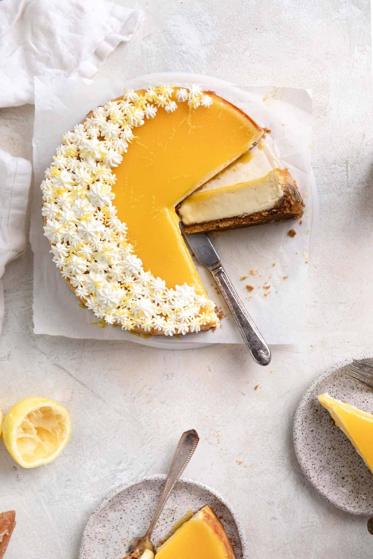 dreamy lemon curd cheesecake with slices cut out