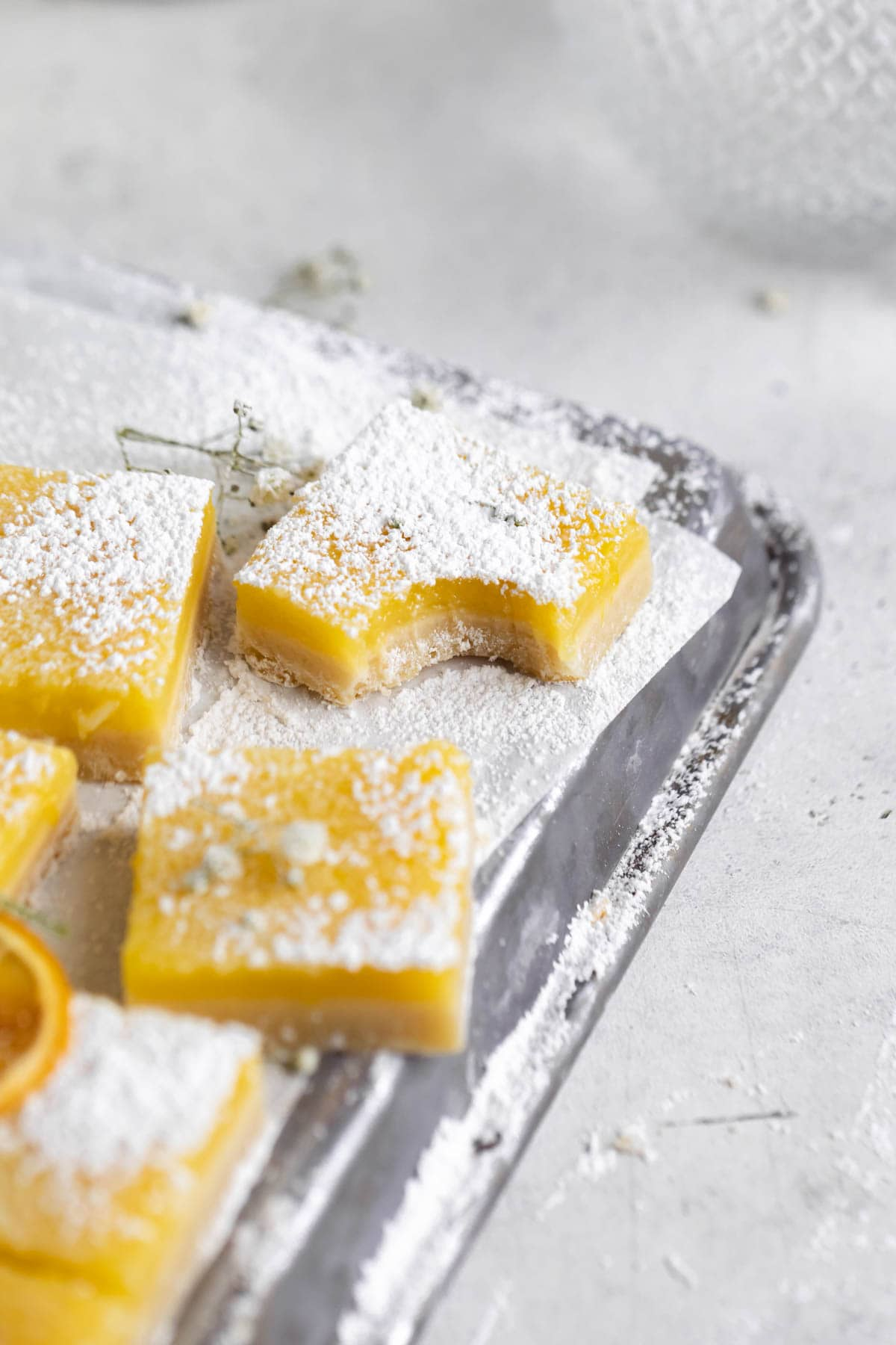 lemon squares with a bite taken out