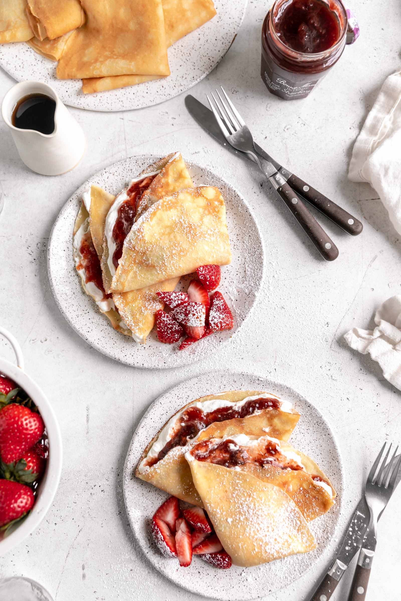 homemade crepes with strawberry jam and whipped cream