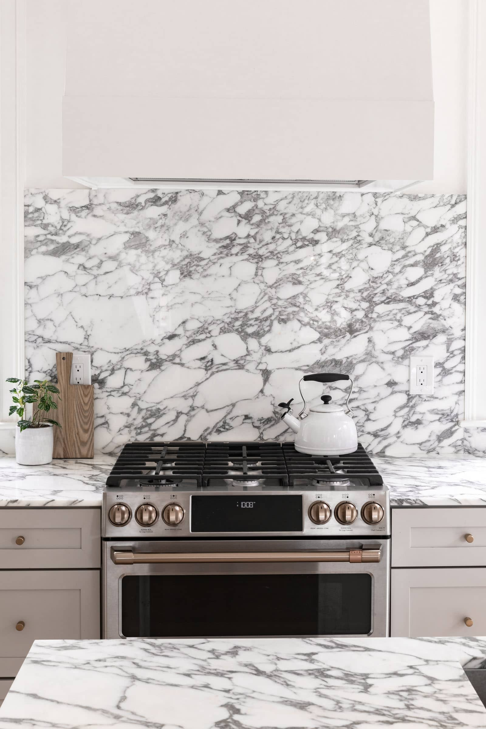 sleek cafe appliance stove in a marble kitchen