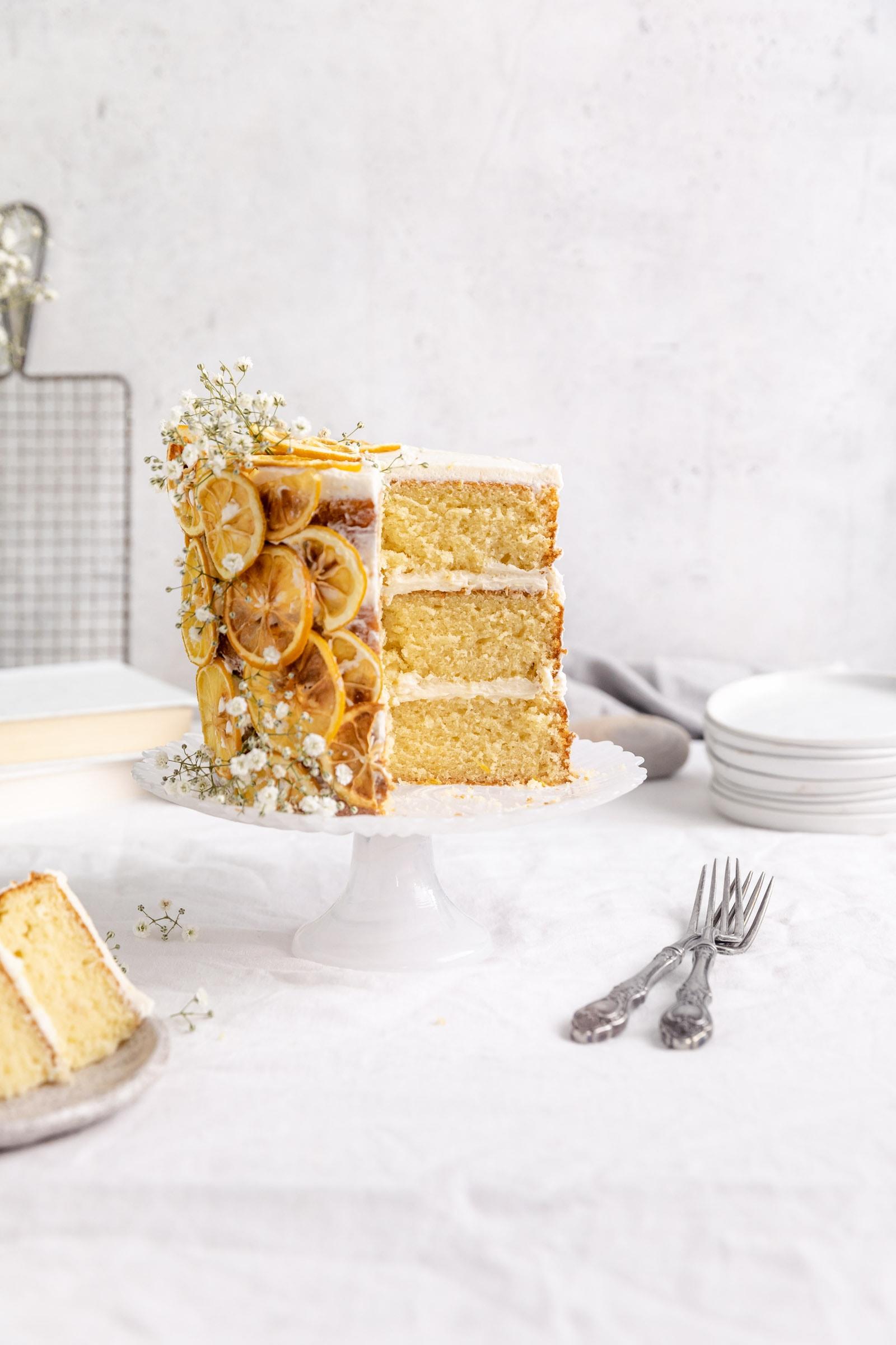 lemon layer cake on a cake stand