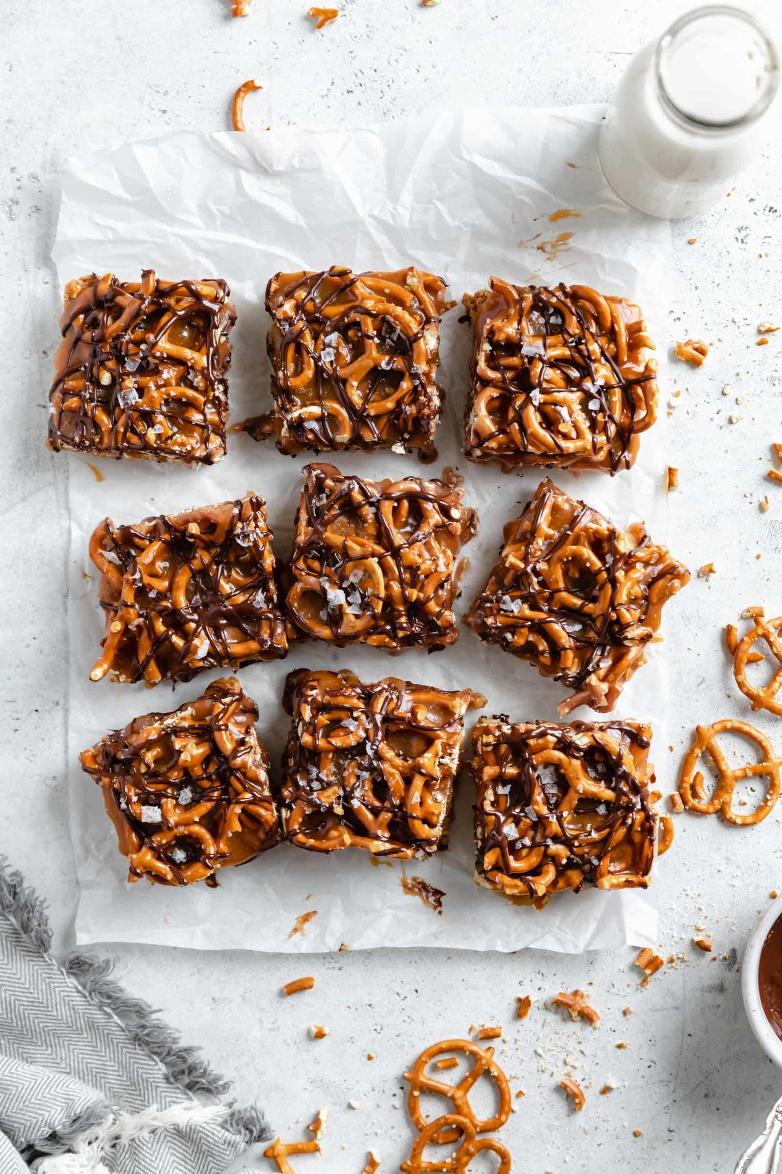 peanut butter pretzels no bake bars drizzled with caramel and chocolate