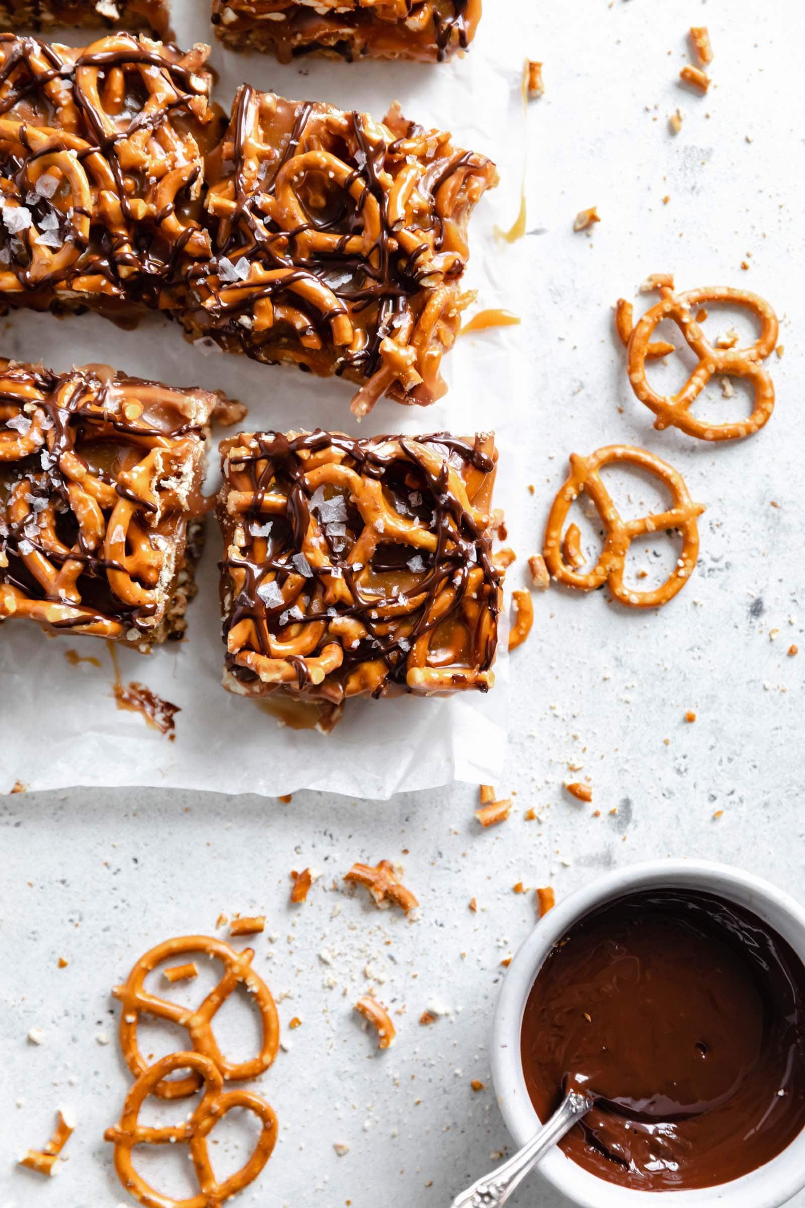caramel peanut butter pretzel bars cut into squares