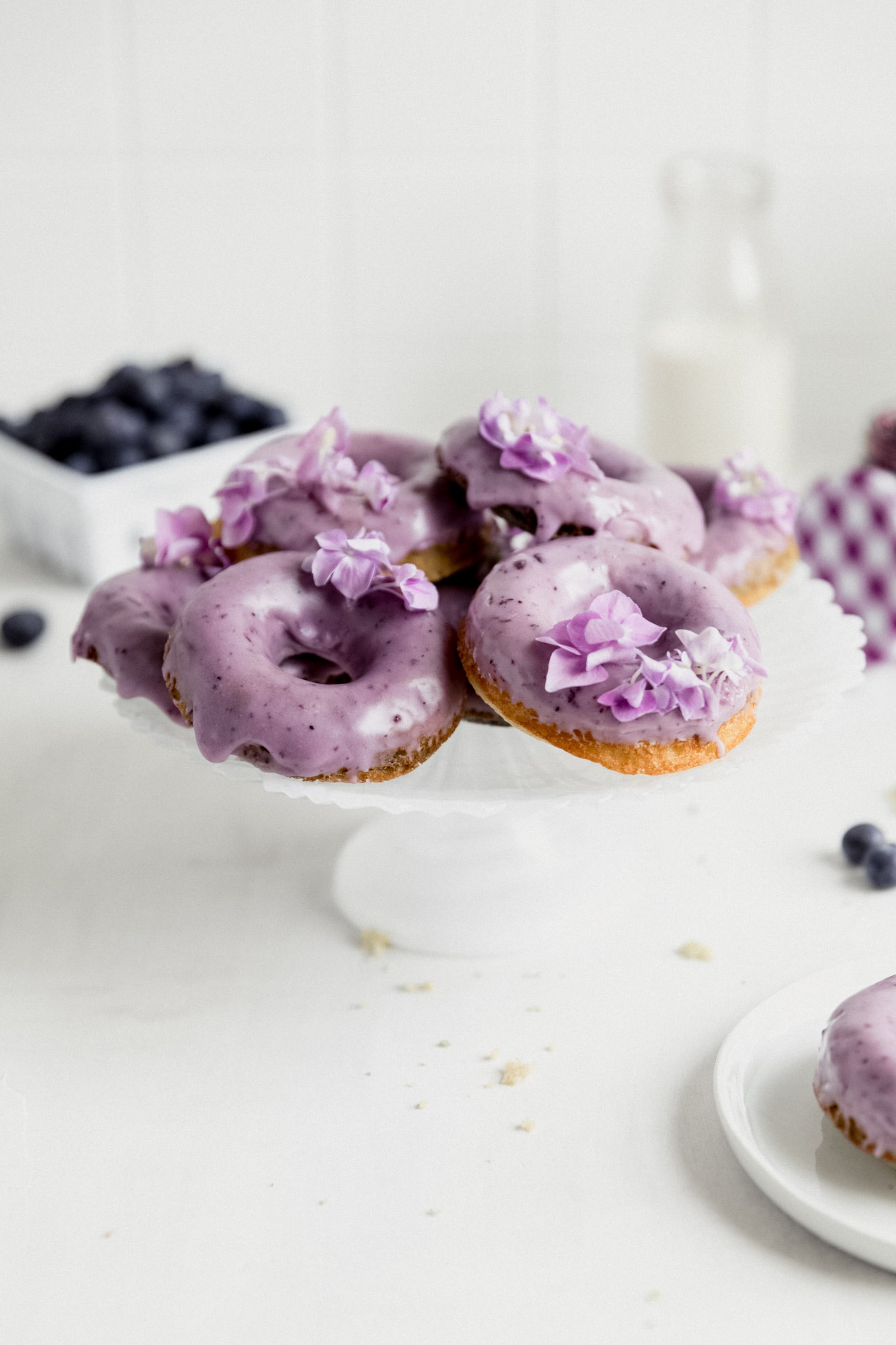 healthy blueberry donuts on a cake stand