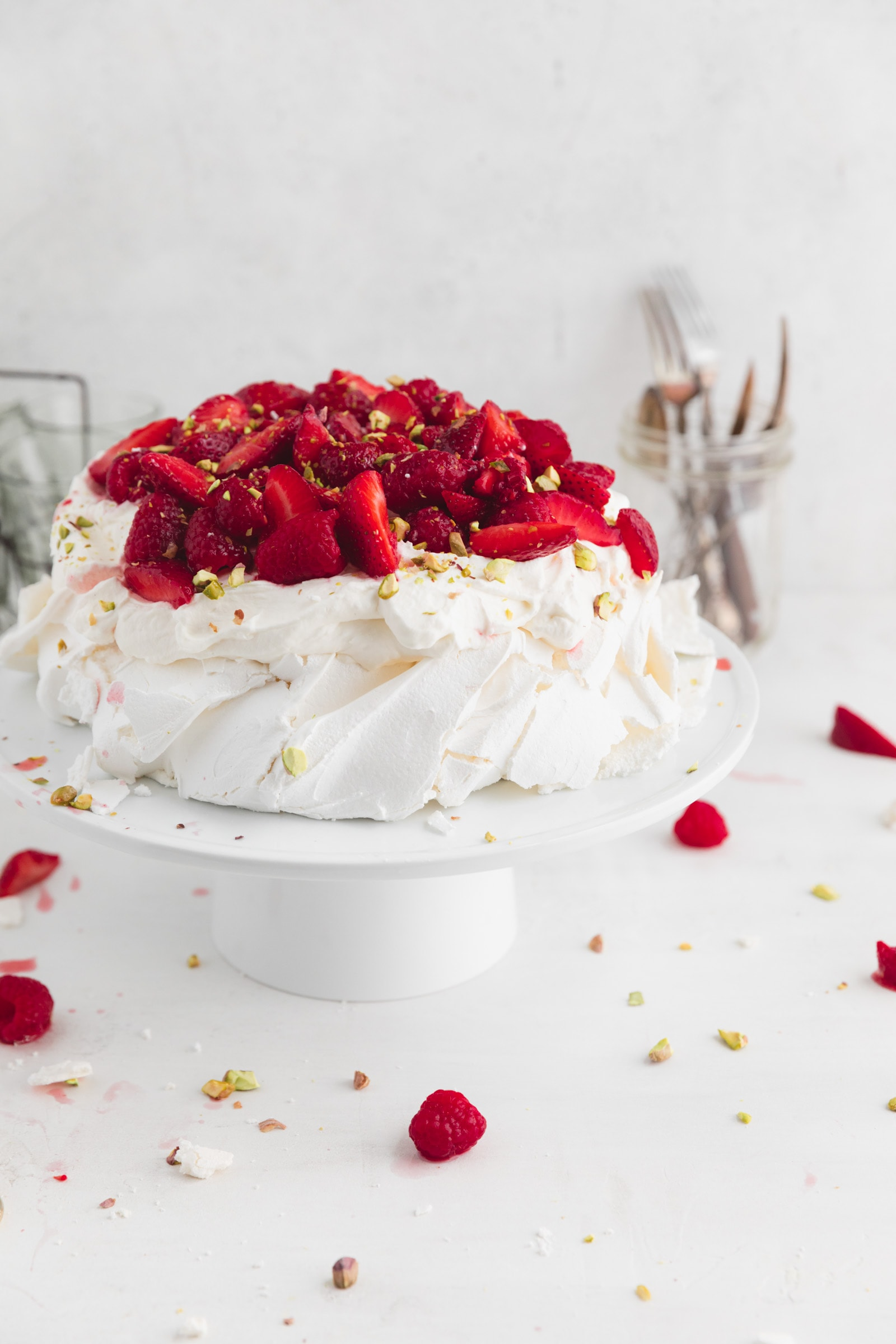 easy pavlova with berries and whipped cream