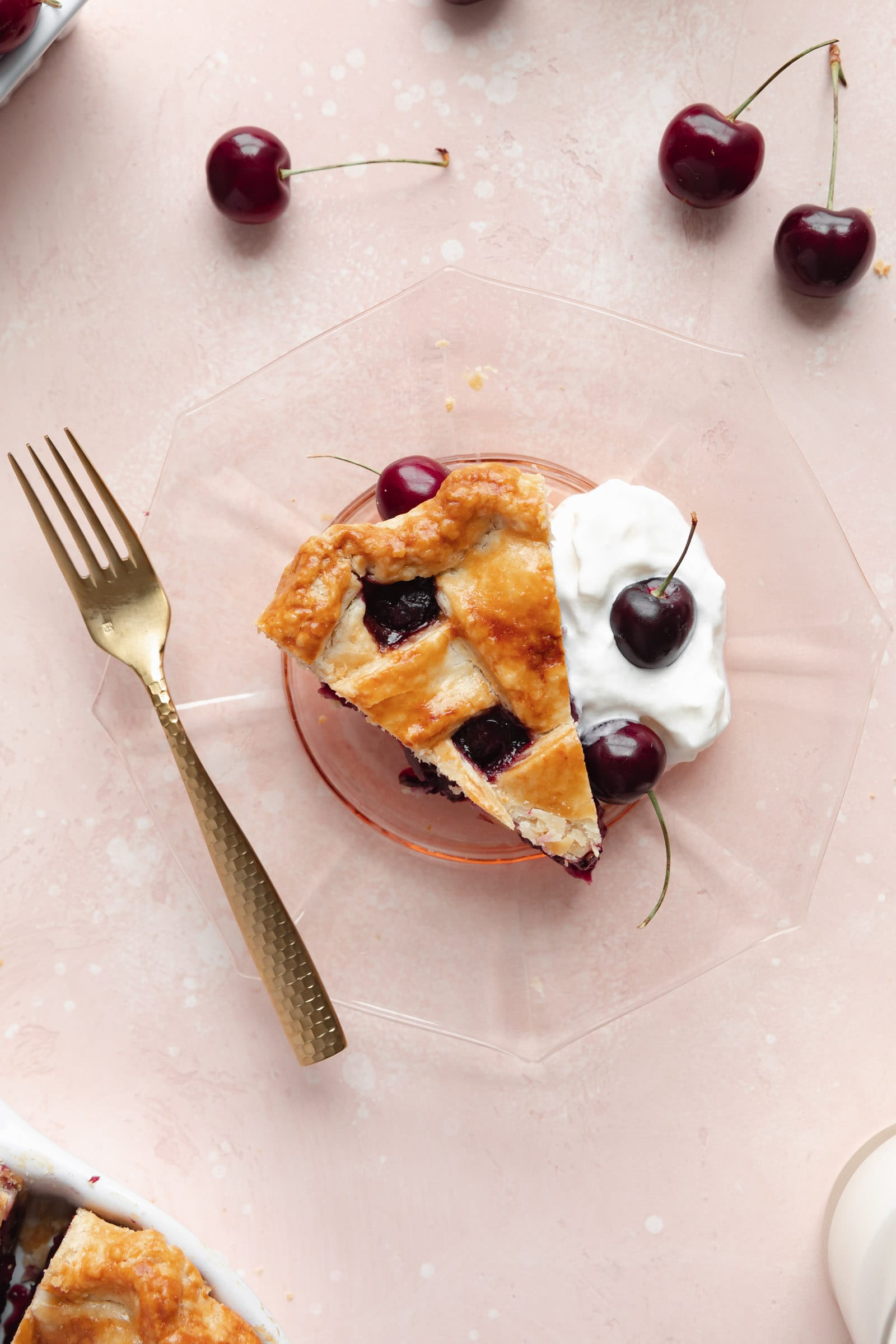 slice of cherry pie with whipped cream