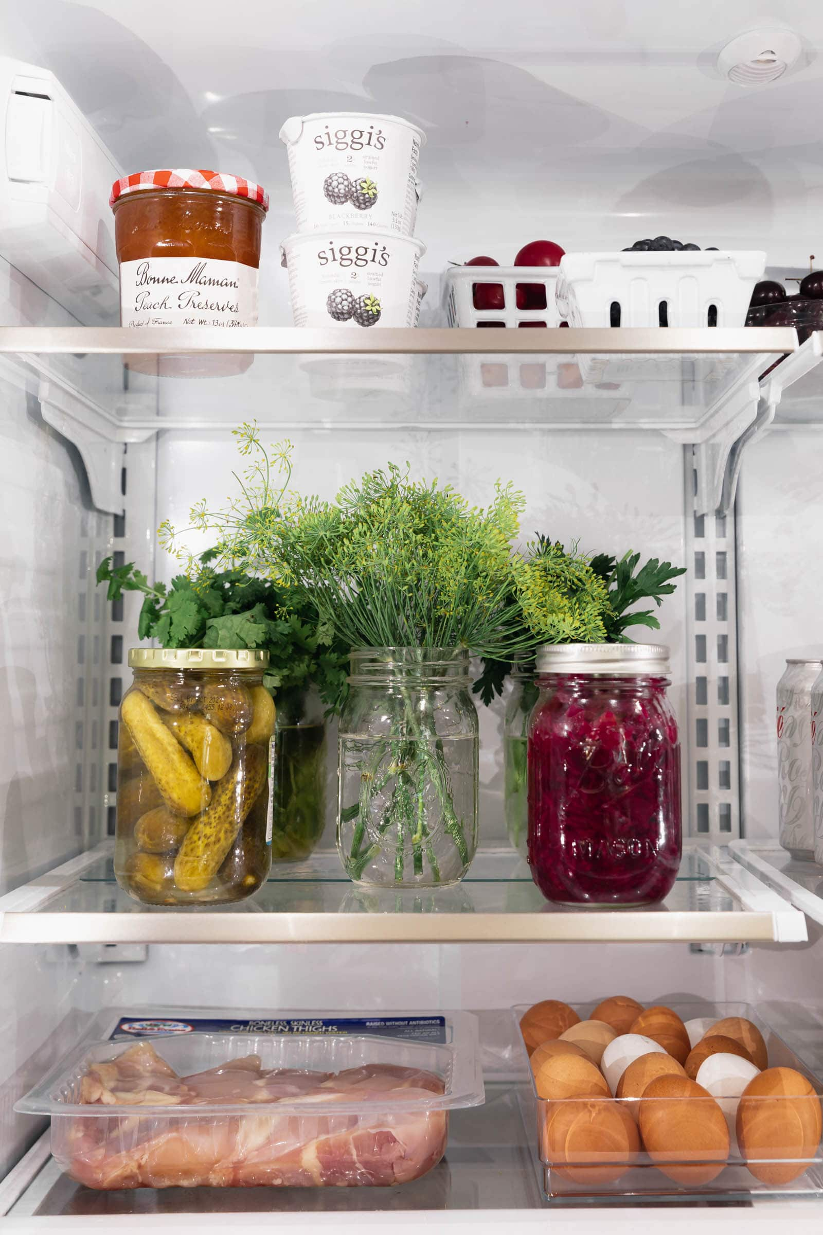 organized fridge with fruits and veggies and meat