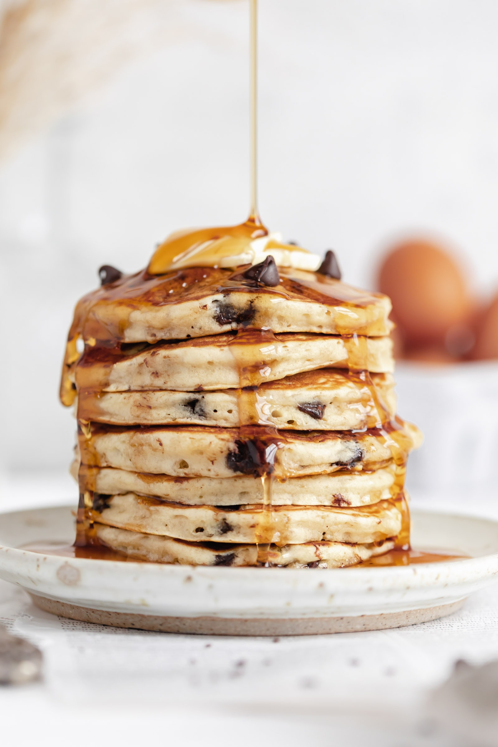 fluffy chocolate chip pancakes with maple syrup