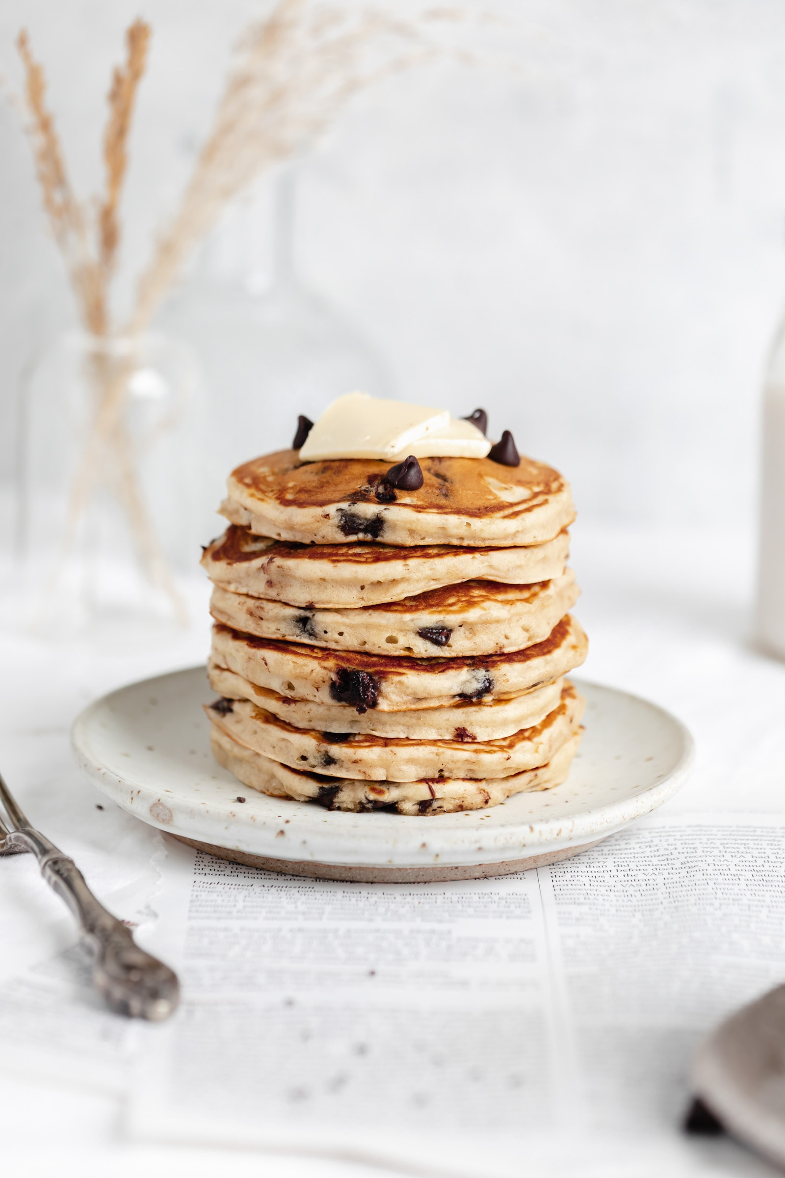 stack of fluffy chocolate chip pancakes with butter