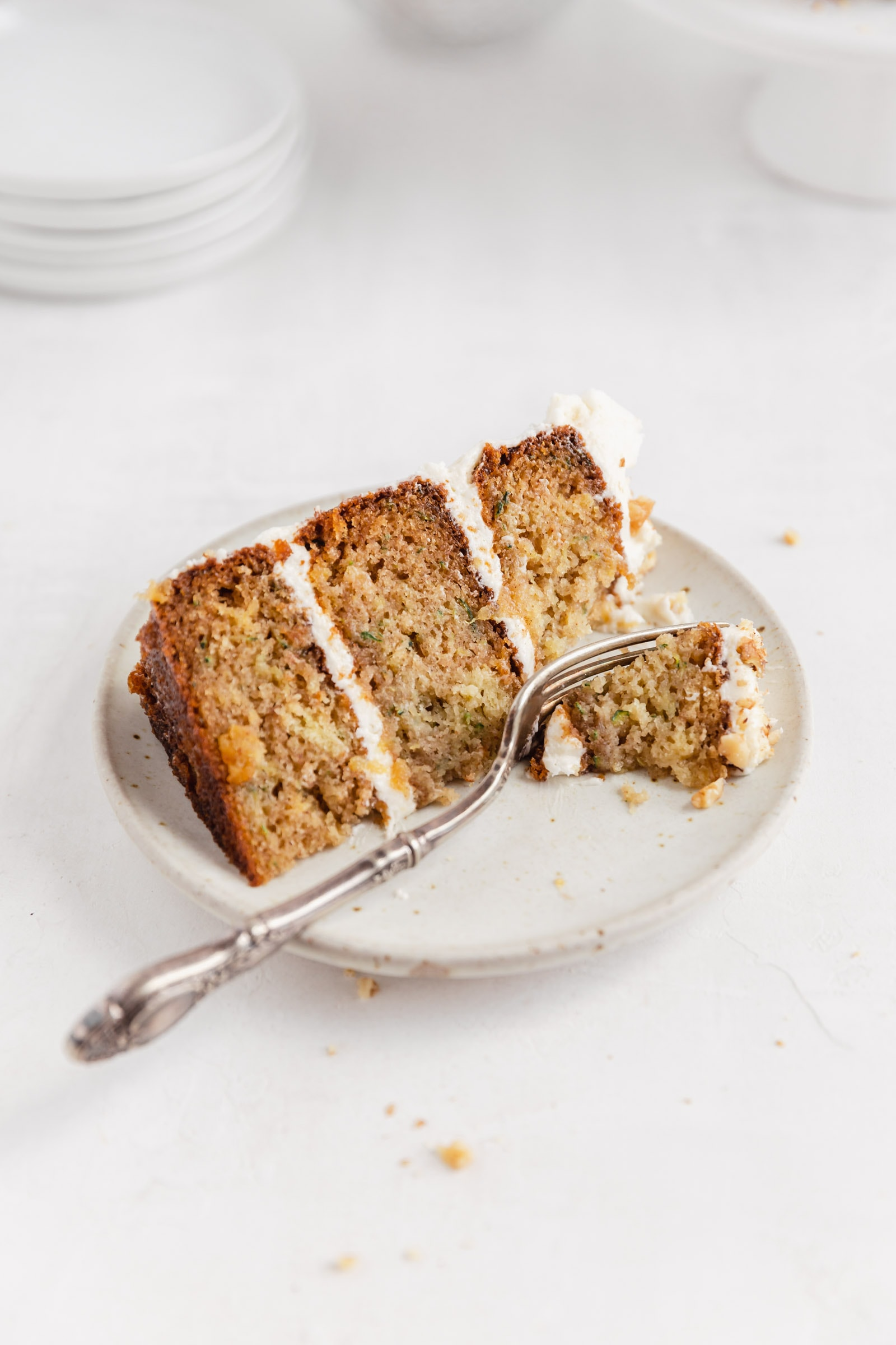 slice of zucchini cake with cream cheese frosting