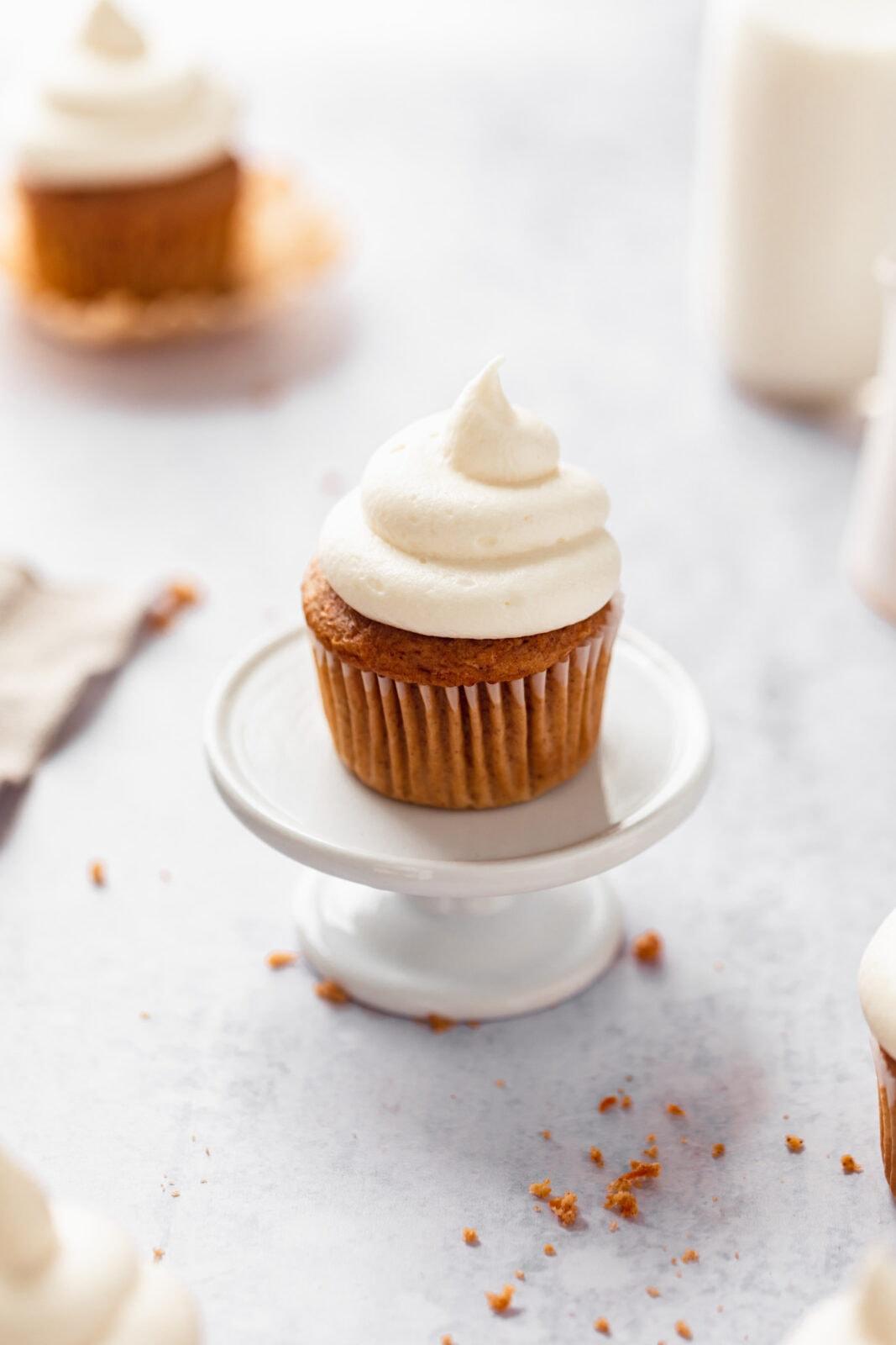 homemade carrot cake cupcake on a cupcake stand
