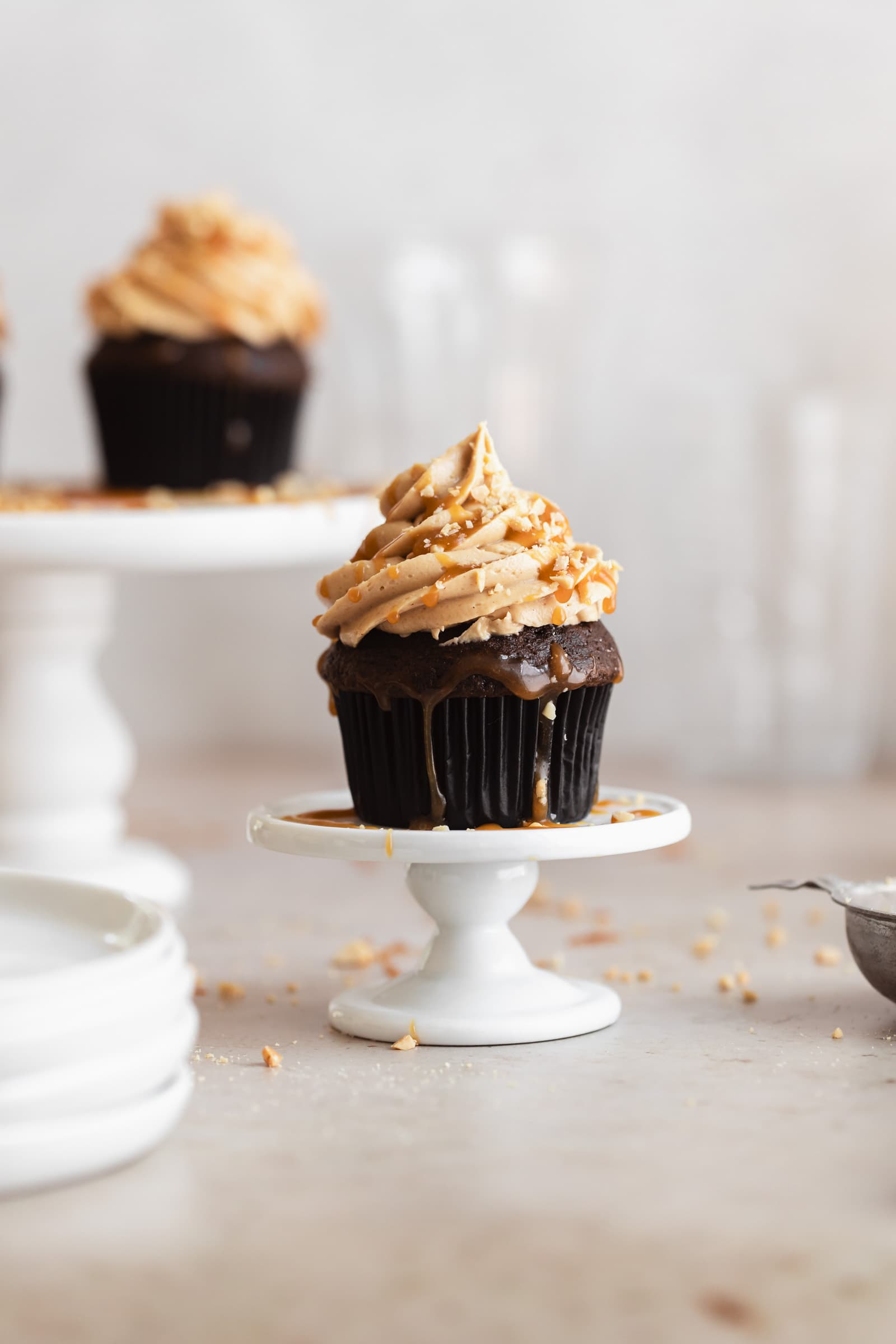 chocolate peanut butter cupcakes with salted caramel drizzle