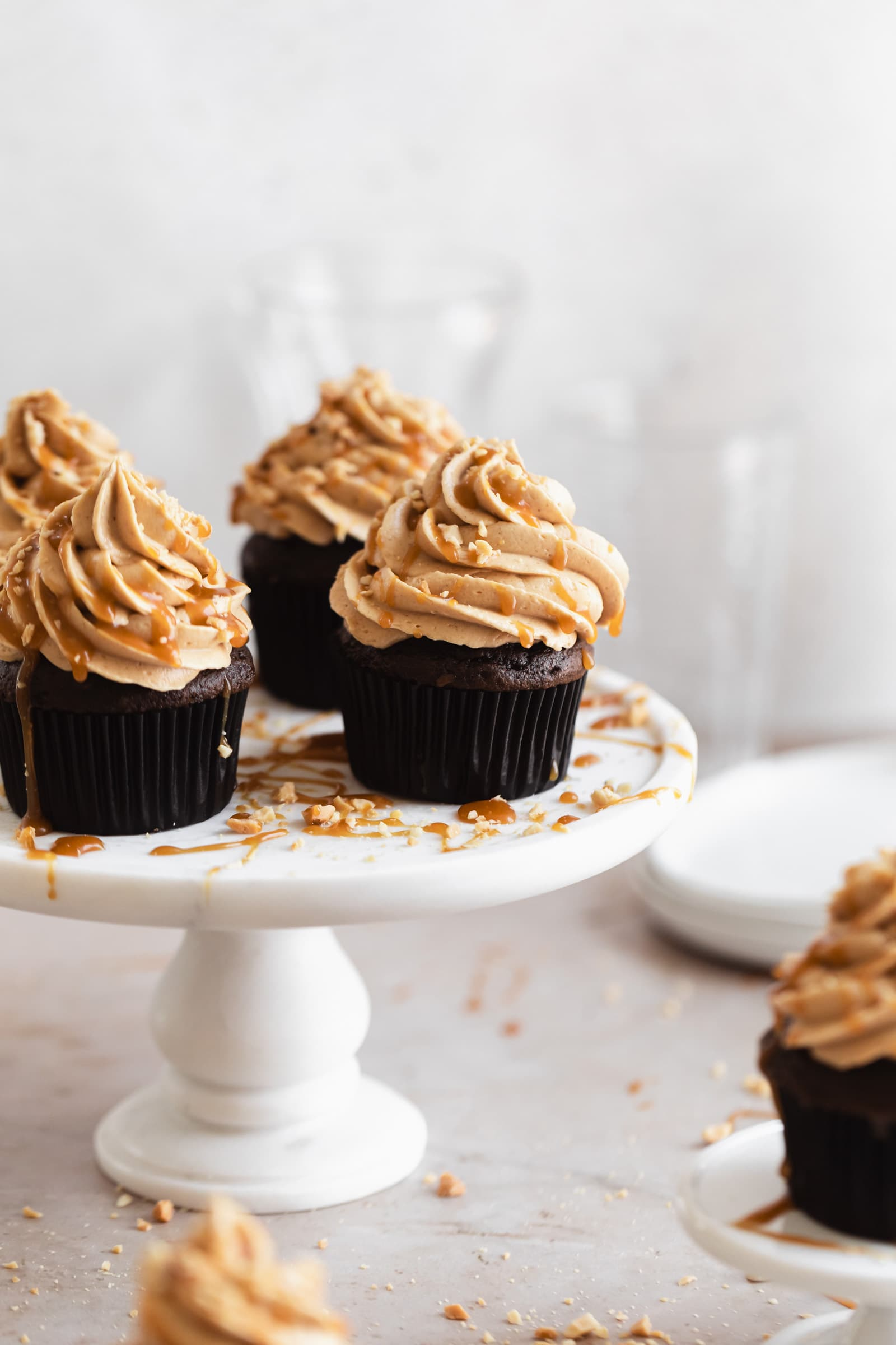 chocolate peanut butter cupcakes with caramel drizzle