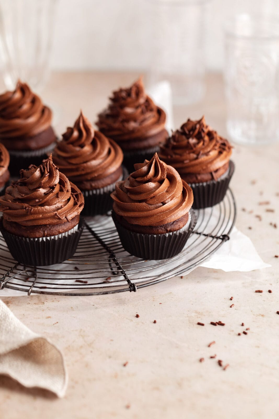 perfect chocolate cupcakes on a cooling rack