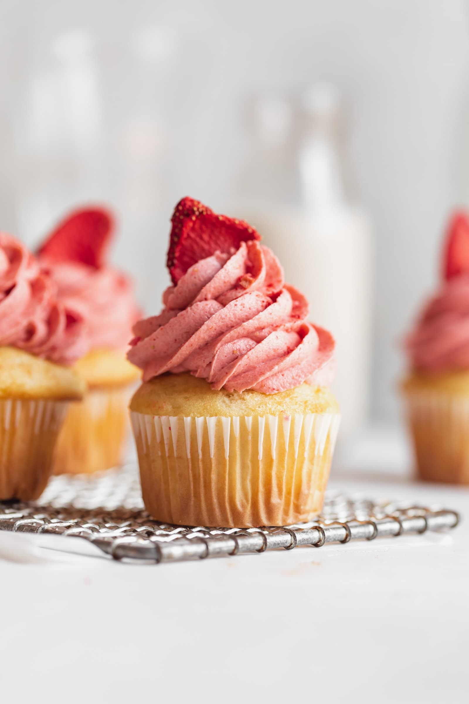 homemade strawberry frosting on a cupcake