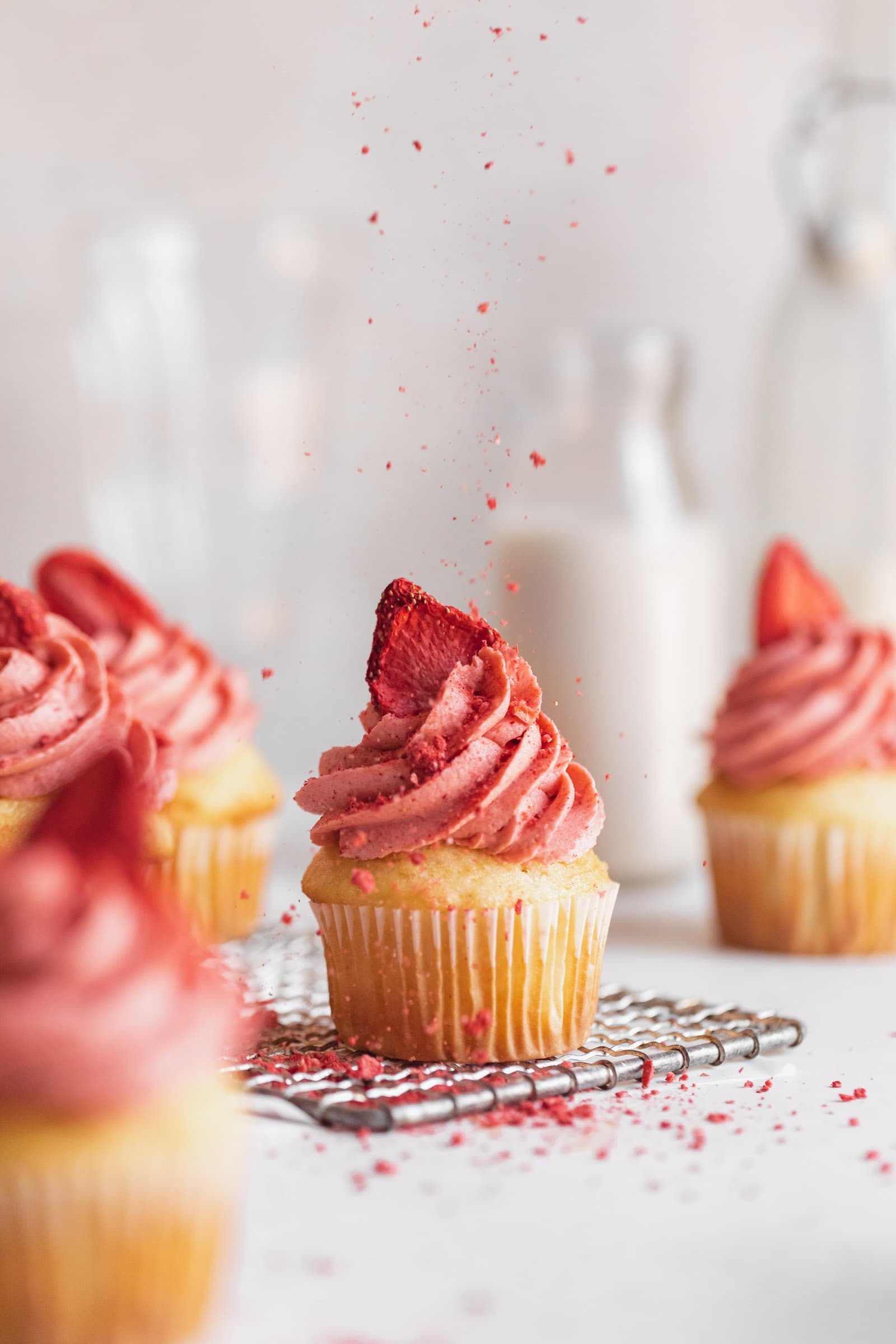 strawberry frosting on a cupcake
