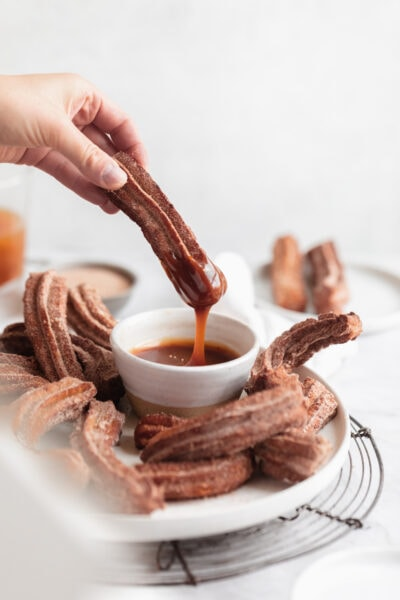 apple cider churros dipped in salted caramel