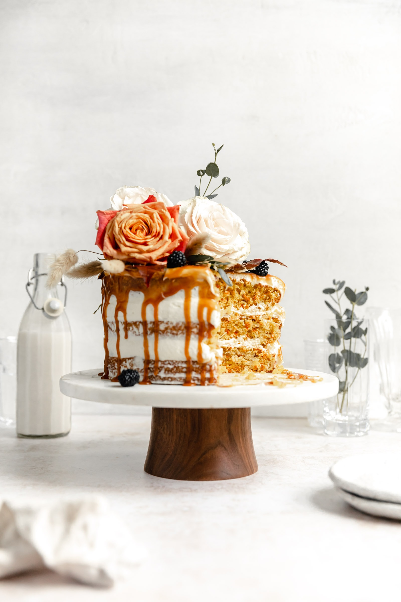 cardamom carrot cake with caramel and flowers