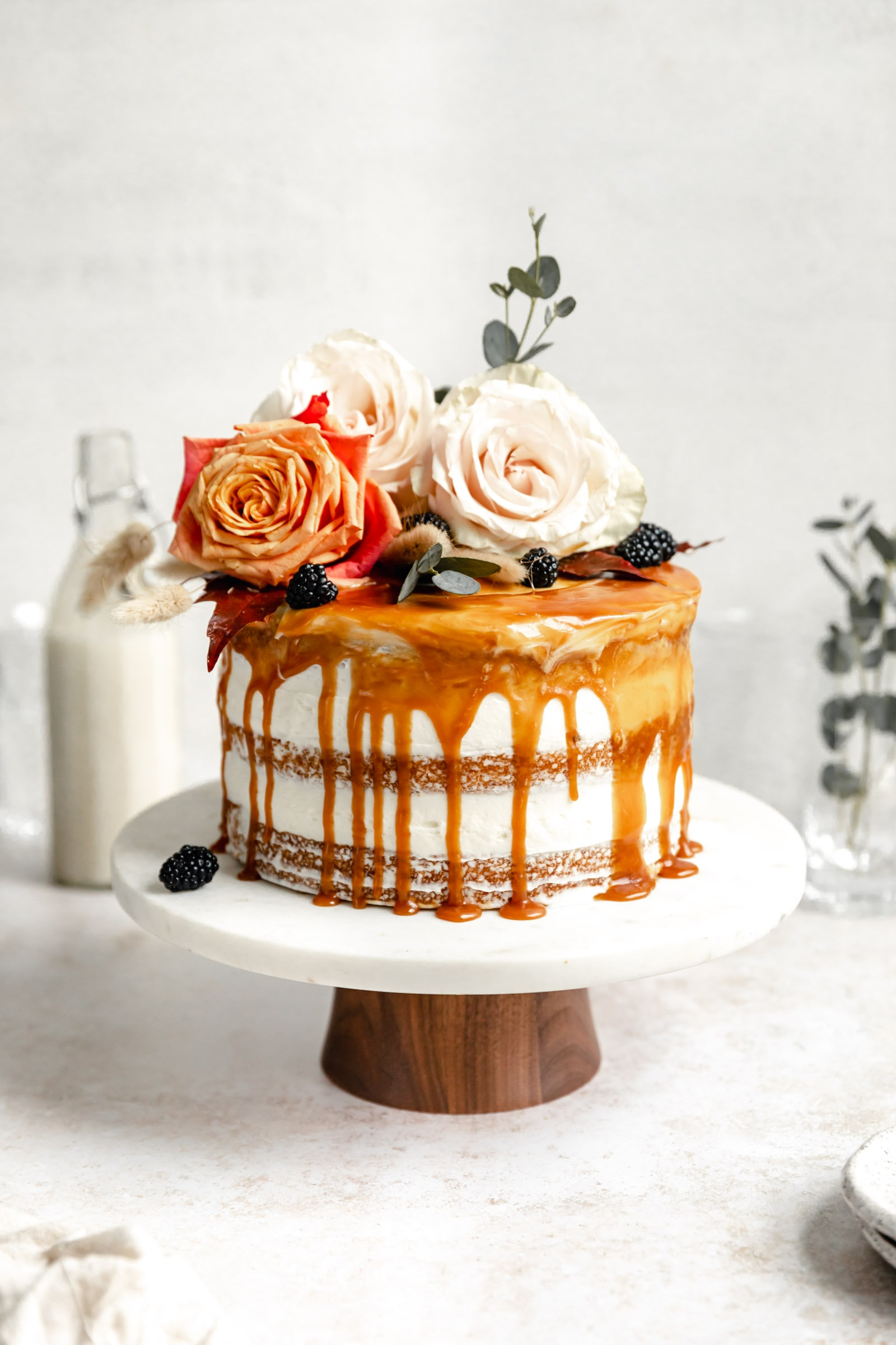 beautiful naked cake with caramel and flowers