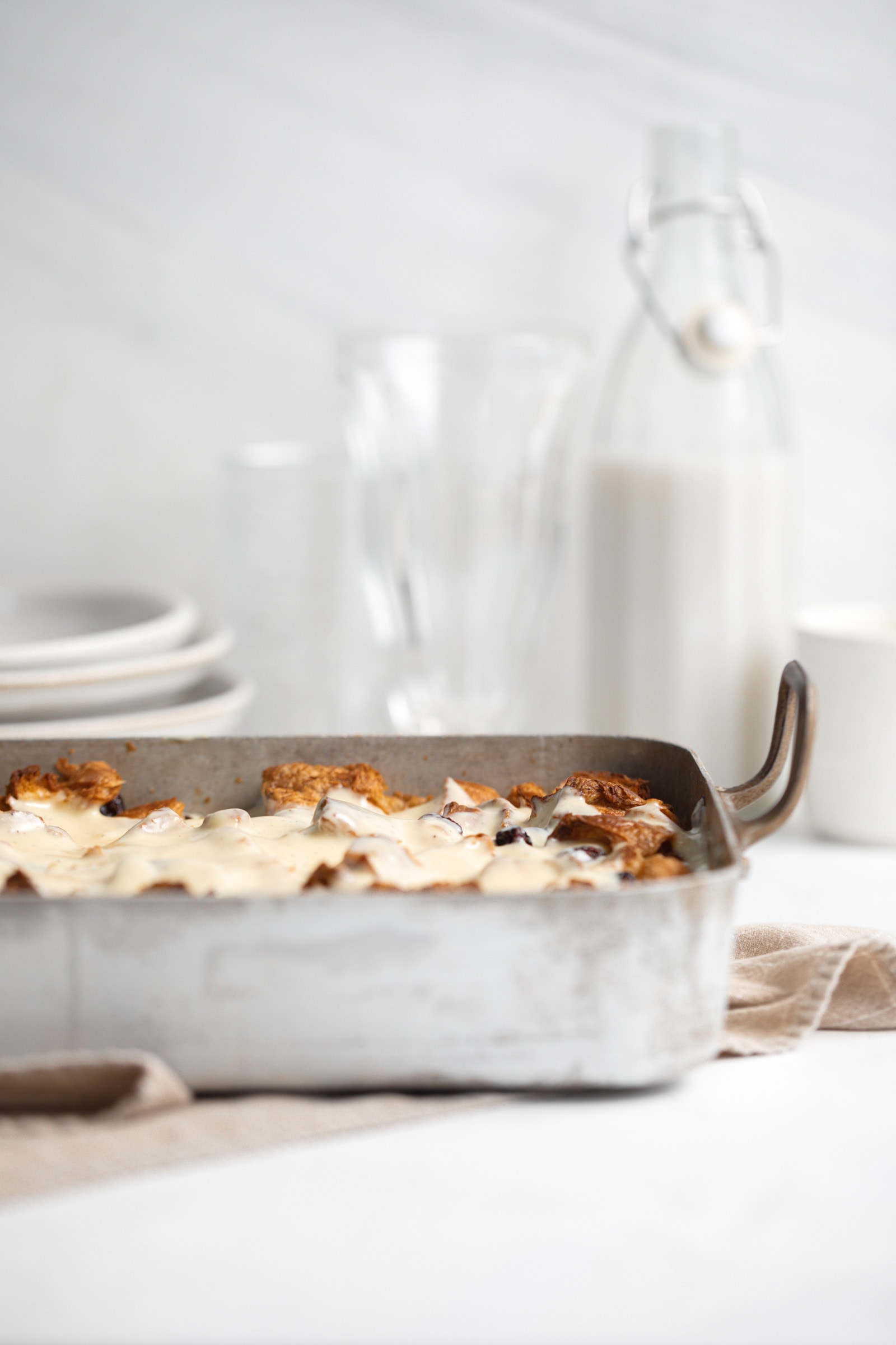 rum raisin bread pudding in a pan