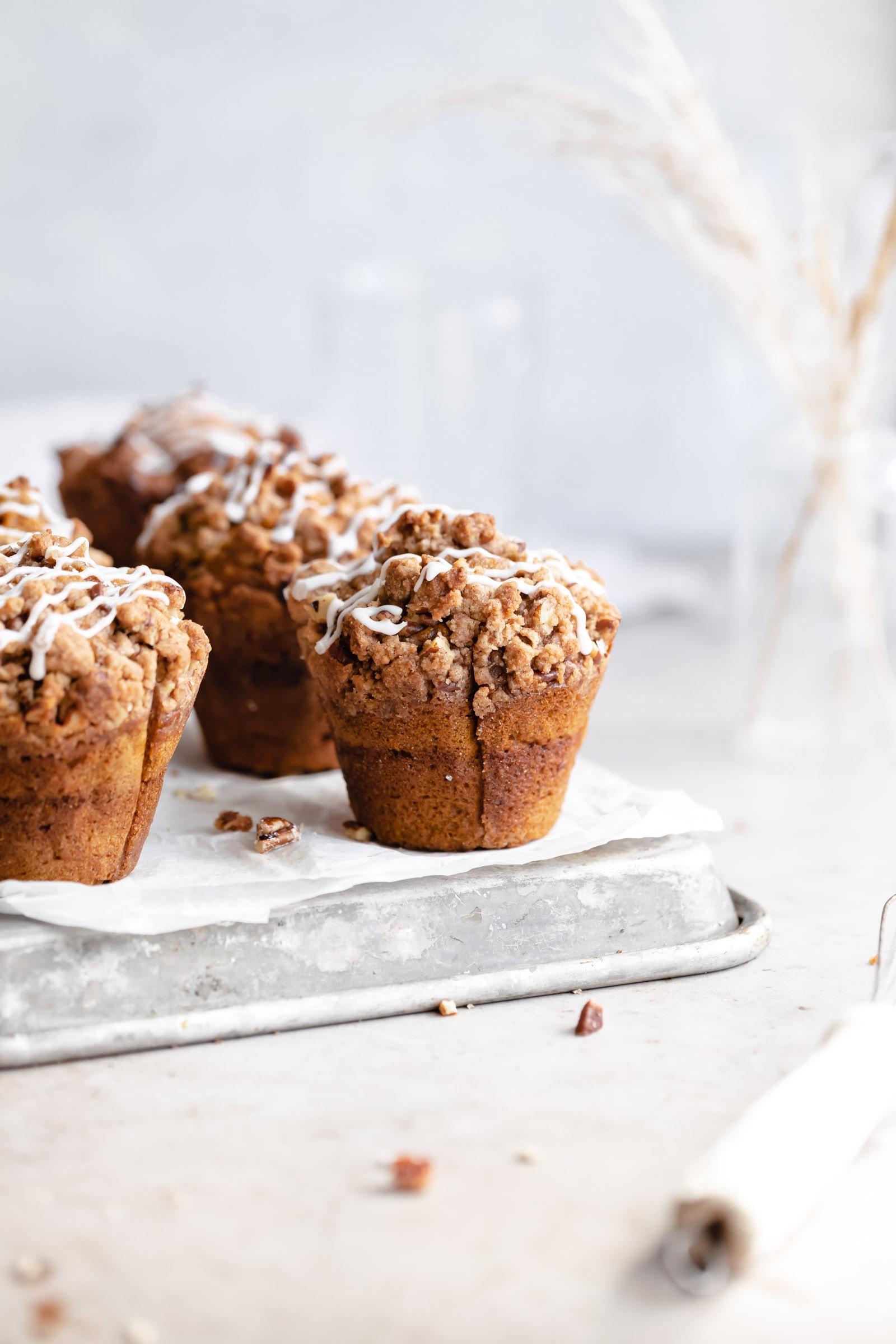 pumpkin muffins on a cookie sheet