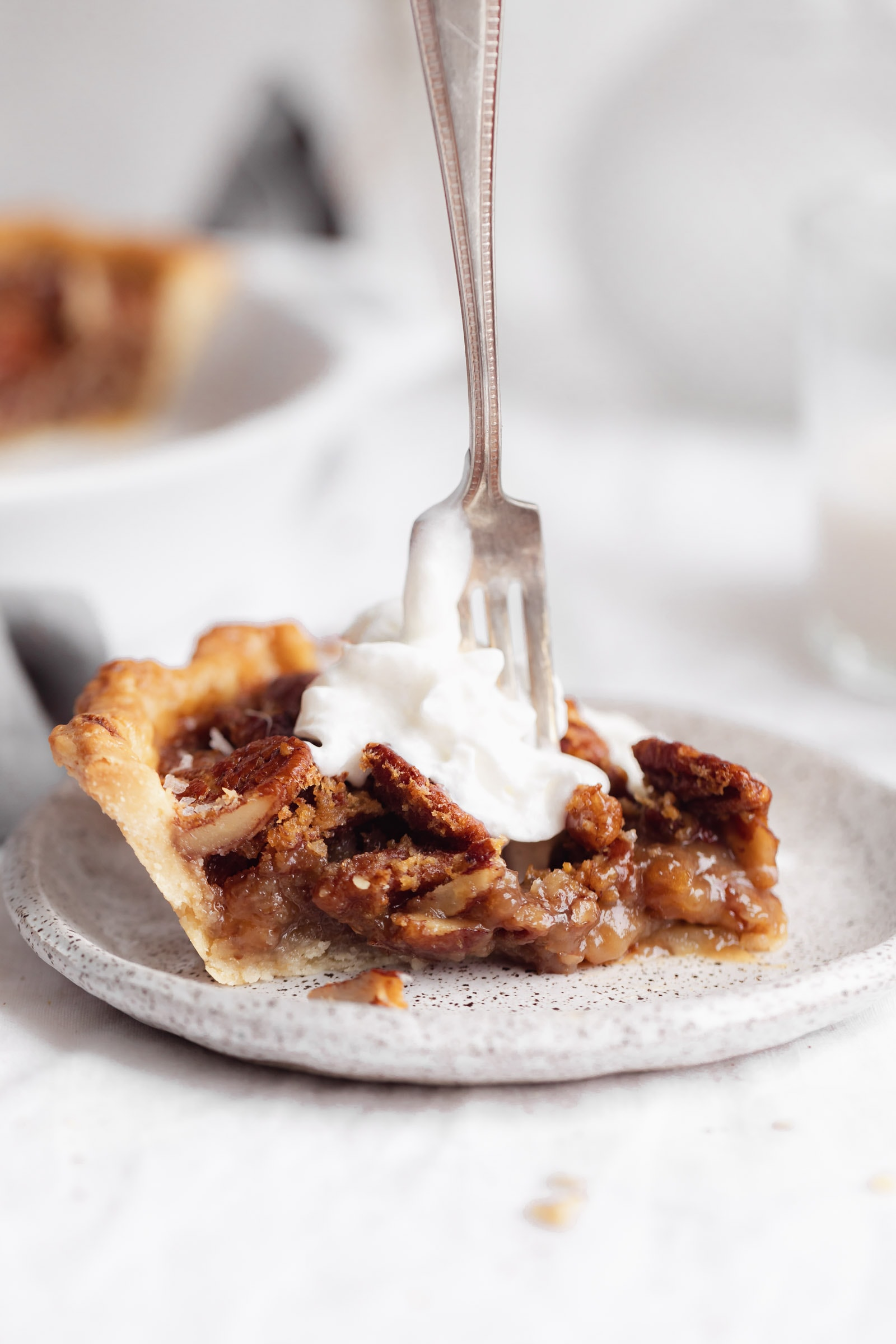 bourbon pecan pie with whipped cream