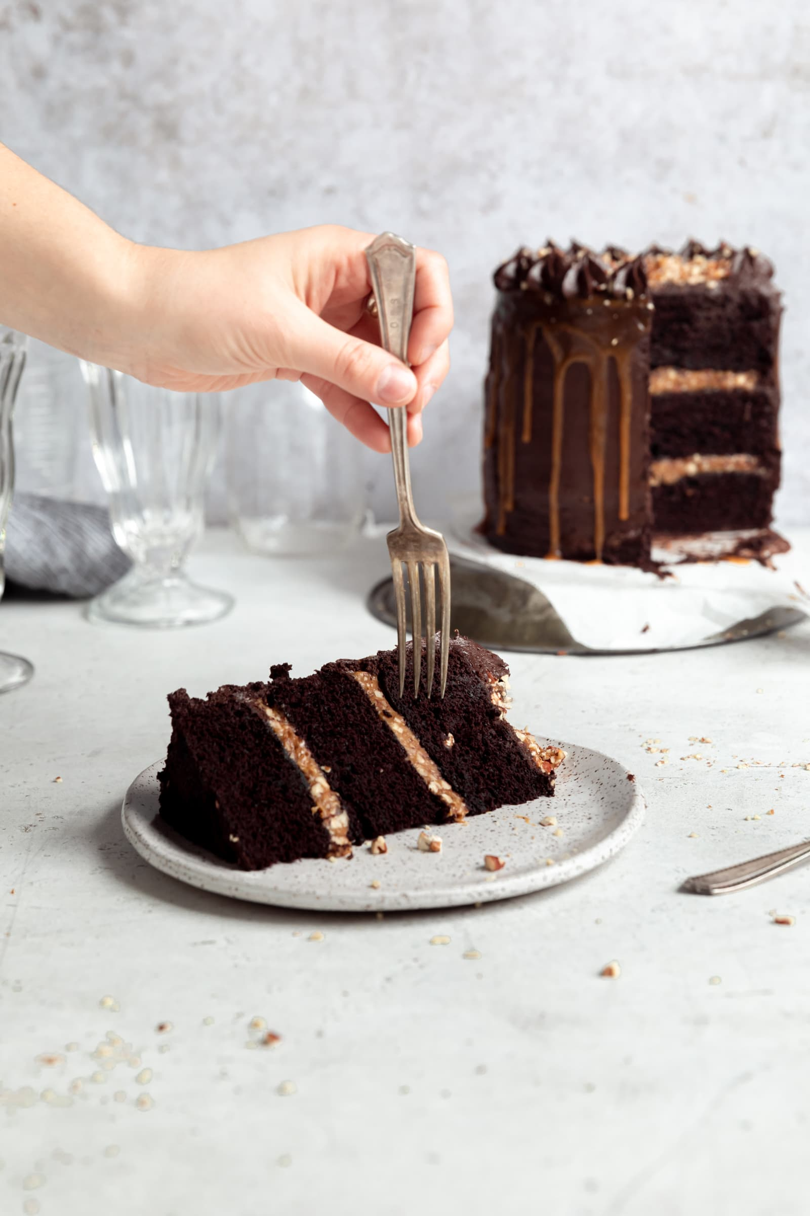 chocolate turtle layer cake slice