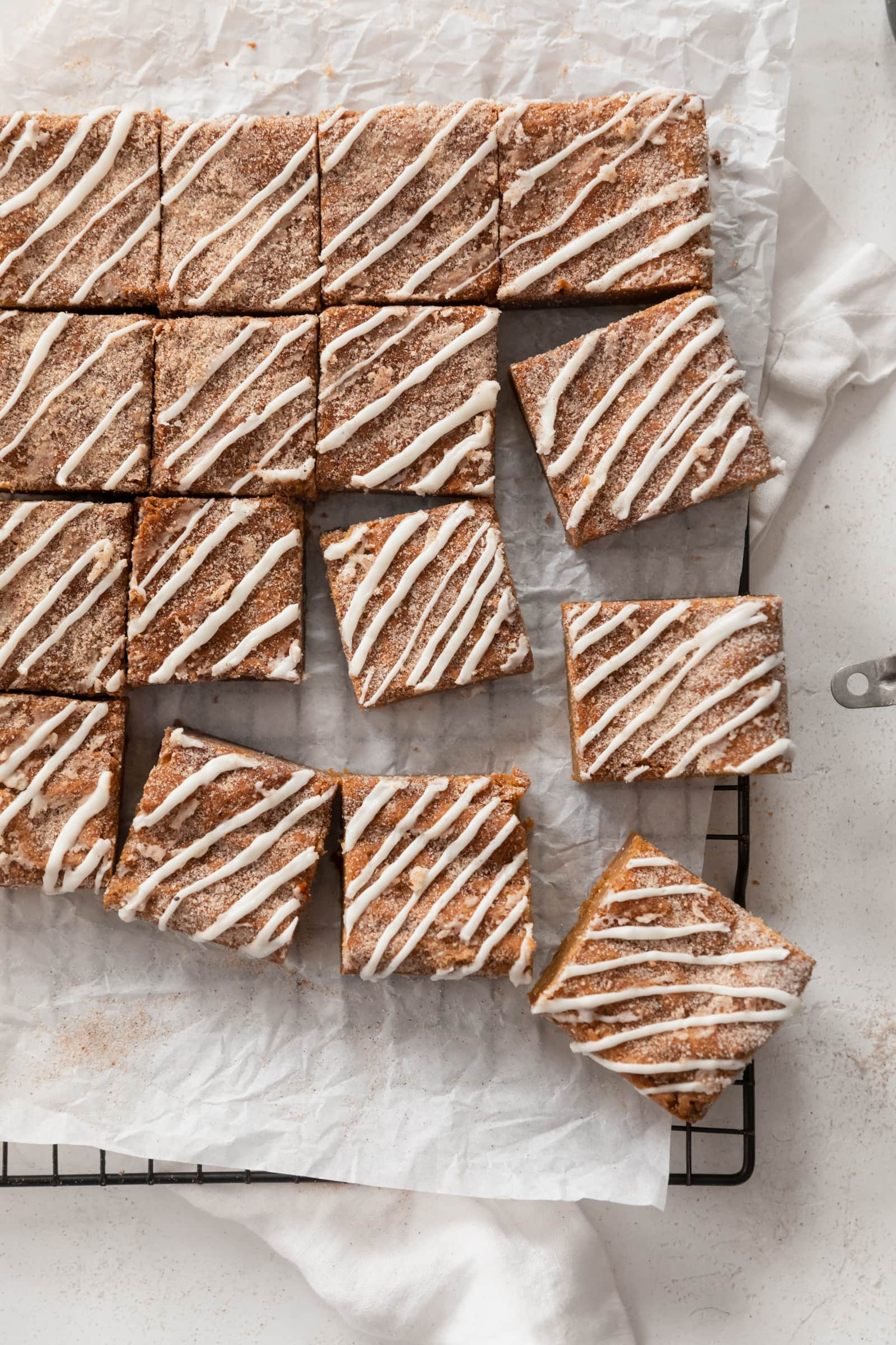 ginger molasses blondies with white chocolate drizzle
