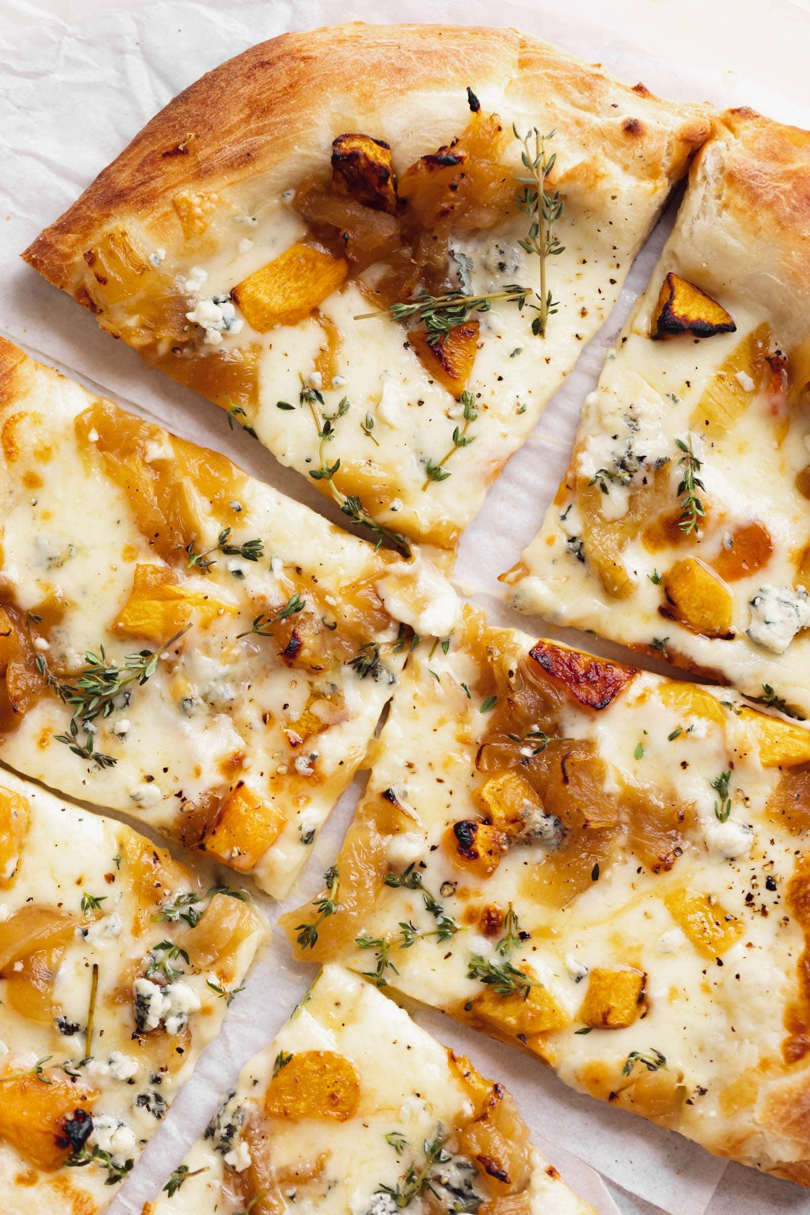 close up harvest pizza with squash, blue cheese and caramelized onions