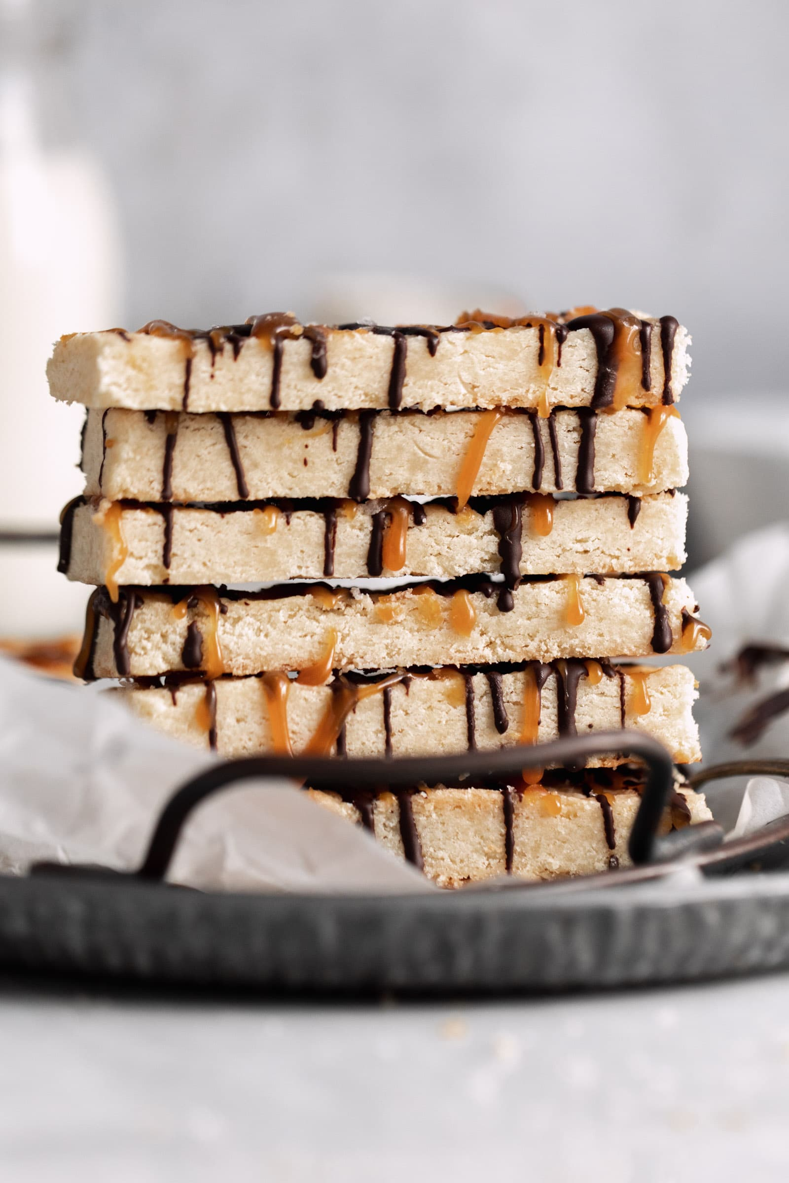 stack of shortbread bars with chocolate and caramel