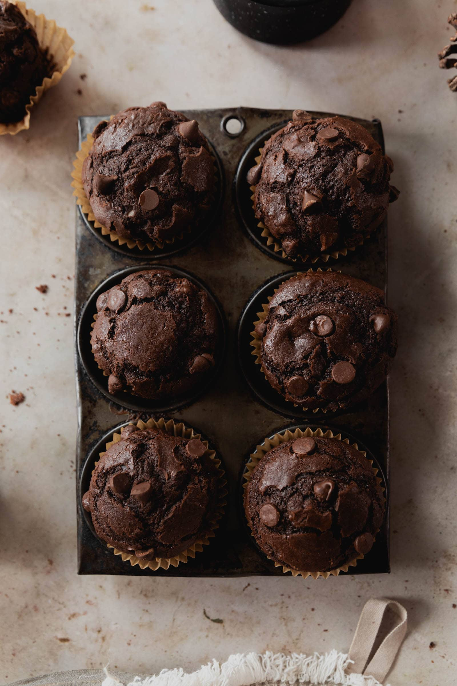 double chocolate muffins in a muffin tin